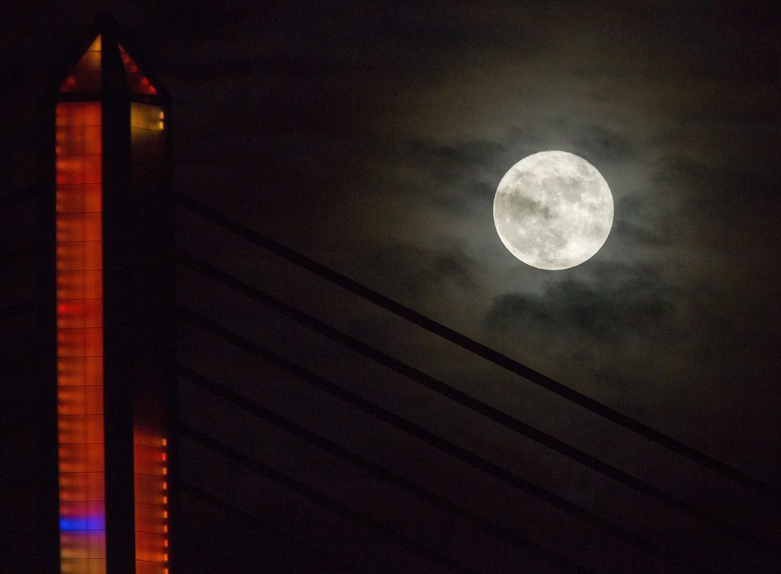 The super moon over the Veteran's Glass City Skyway Bridge in downtown Toledo photographed on Monday, Nov. 14, 2016.