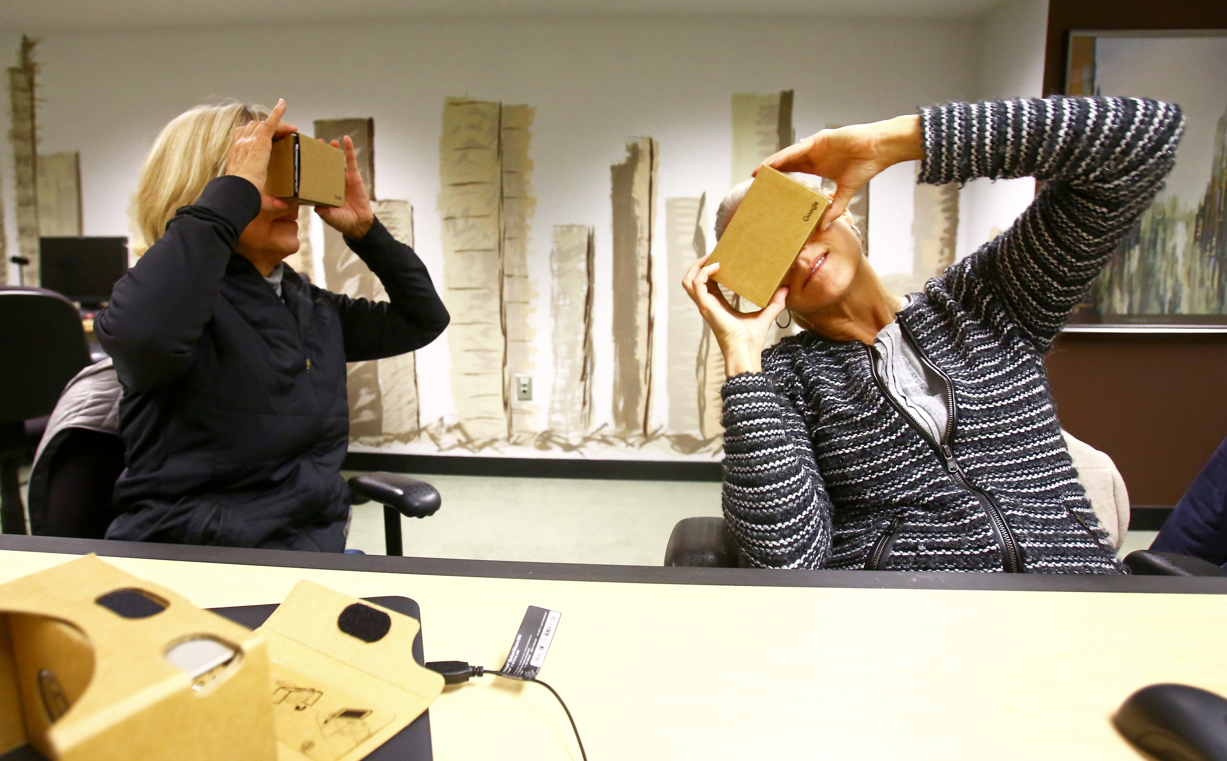 Carol Martin of Toledo, left, and Annie Yunger of Holland test out their freshly assembled Google Cardboard virtual reality headsets during a Make and Take: Build your own Virtual Reality Headset class held at the Way Public Library in downtown Perrysburg, Oh. on Monday, Dec. 5, 2016. Yunger was brought along with Martin who signed up for the class because she wanted to stay up to date on the latest technology for her grandchildren.