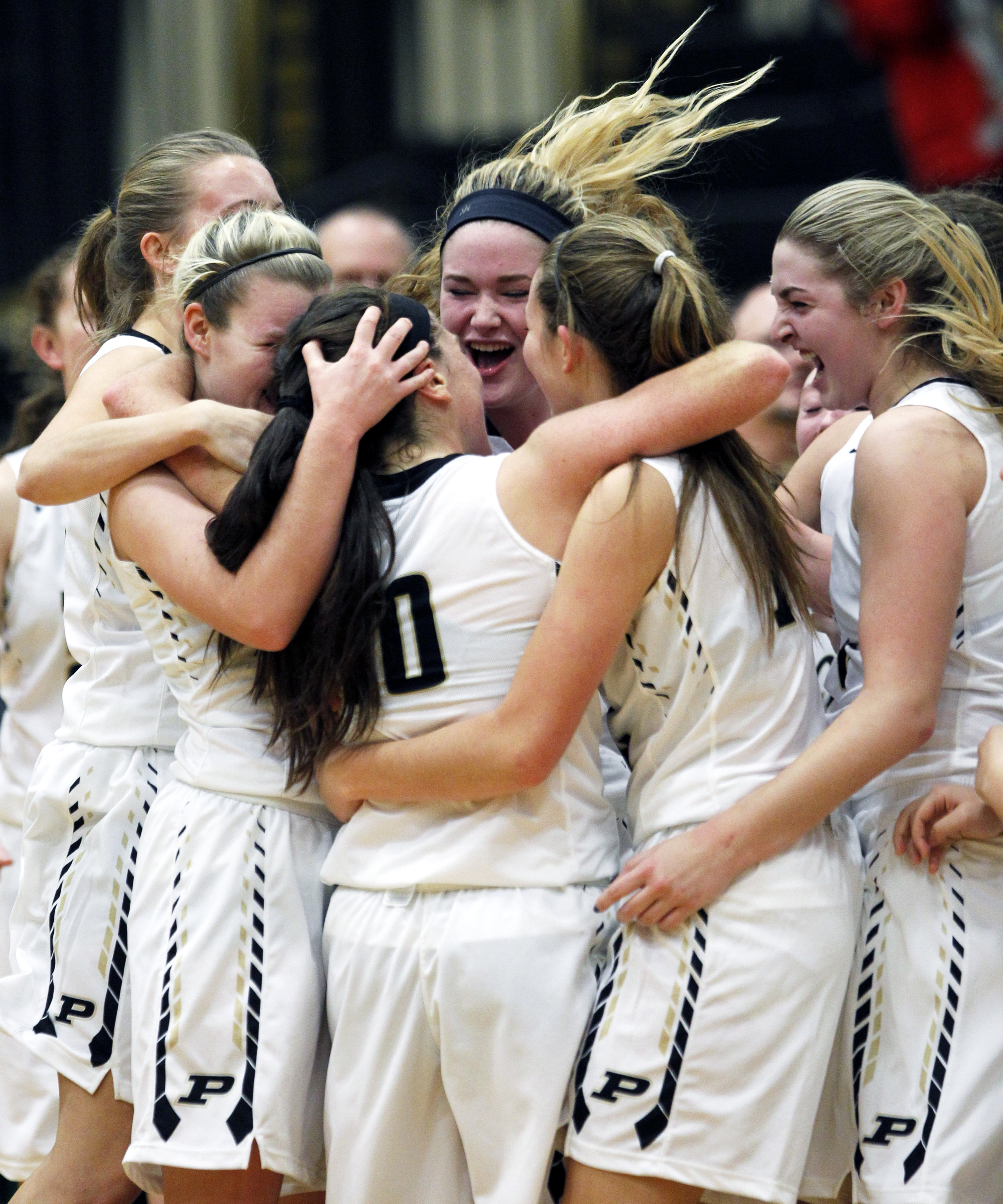 The Perrysburg High School varsity girl's basketball team celebrates the 3-point basket scored by guard Kristina DeMarco (10) at the buzzer sending the girl's varsity basketball game against Sylvania Northview High School into it's first overtime at Perrysburg High School on Thursday, Dec. 8, 2016. Perrysburg won the game double overtime 58-53.