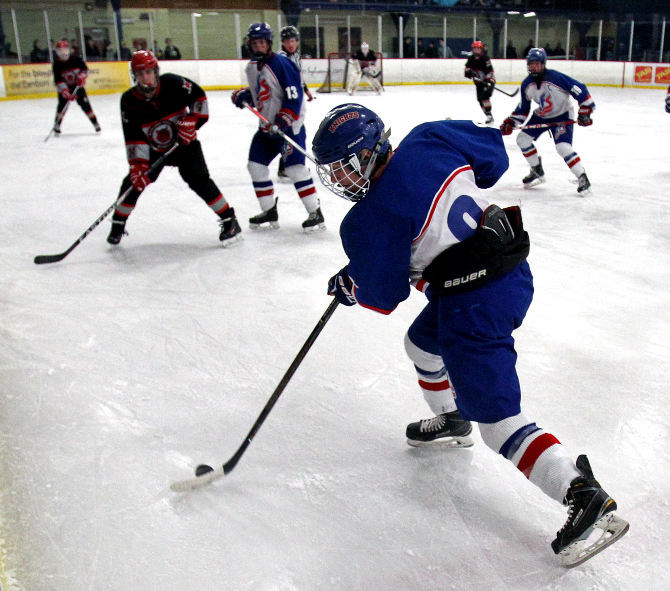 St. Francis de Sales defender Nick Kozma (8) moves the puck down rink while Bowling Green High School's Ryan Tyrrell blocks his path during the boy's hockey game at Tam-O-Shanter ice Arena in Sylvania Oh. on Friday, Dec. 9, 2016.