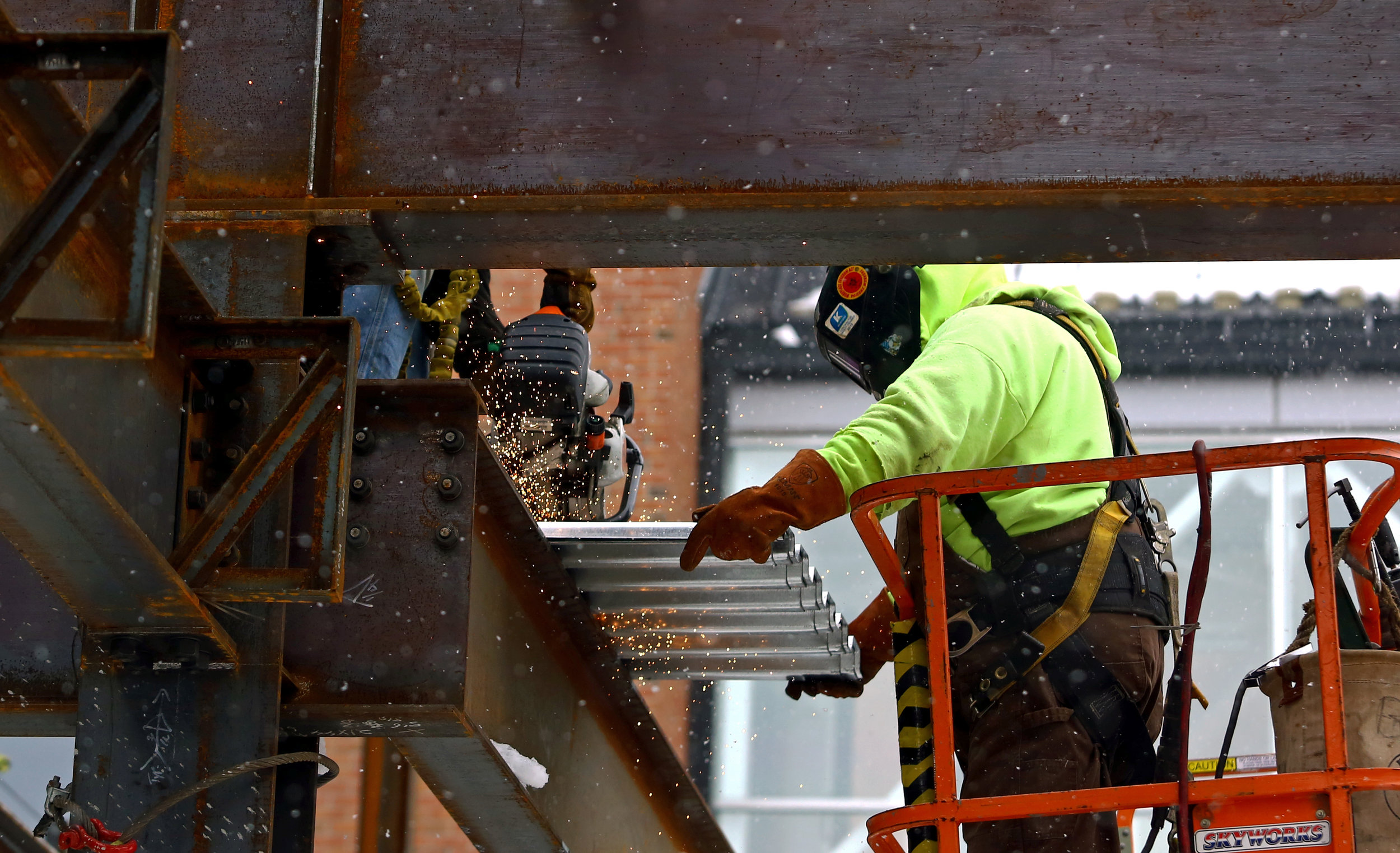 Adam Wilbur, left, of Toledo and Robert Bacon, right, work on cutting sections of roofing for the new emergency wing under construction at Mercy St. Vincent Hospital on Cherry Street in Toledo, Oh. on Tuesday, Dec. 13, 2016.