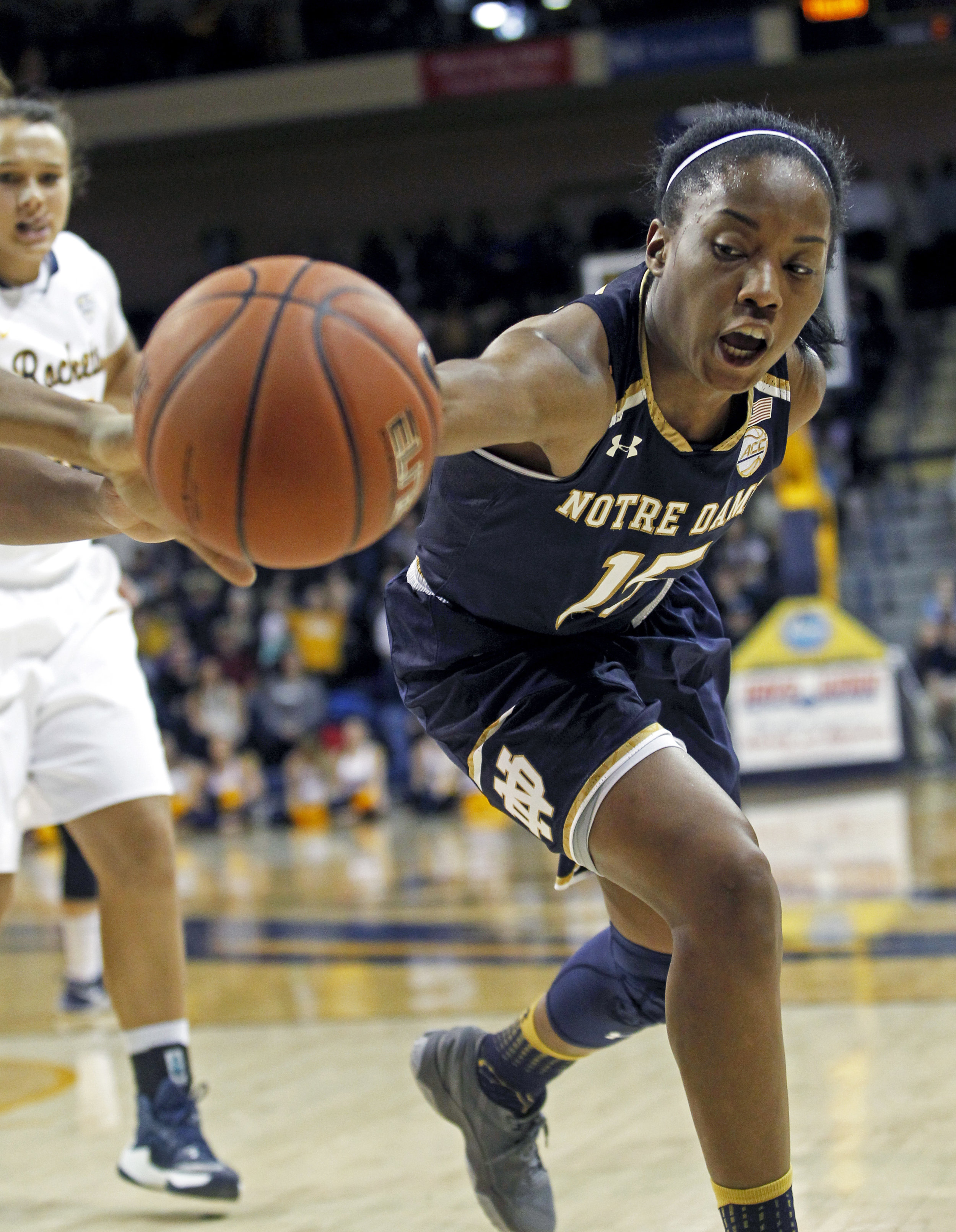 Notre Dame guard Lindsay Allen (15) reaches for a loose ball in an attempt to keep it from going out of bounds during the women's basketball game at Savage Arena on the University of Toledo's campus on Sunday, Dec. 18, 2016.