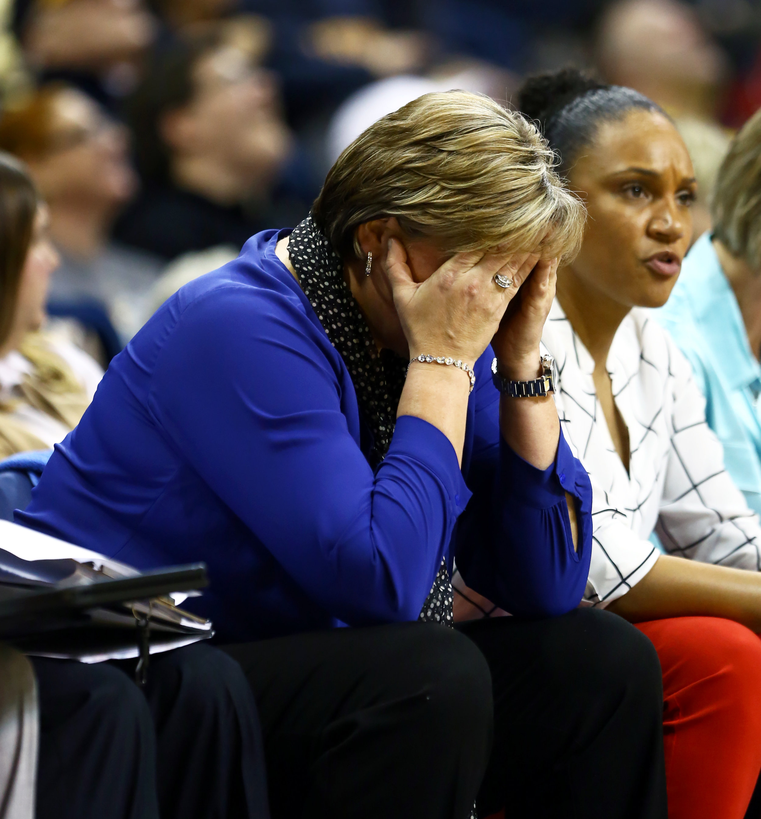 University of Toledo women's basketball head coach Tricia Cullop holds her head in her hands on the bench after a turn over to Notre Dame during the women's basketball game at Savage Arena on the University of Toledo's campus on Sunday, Dec. 18, 2016. Notre Dame won the game 85-68.