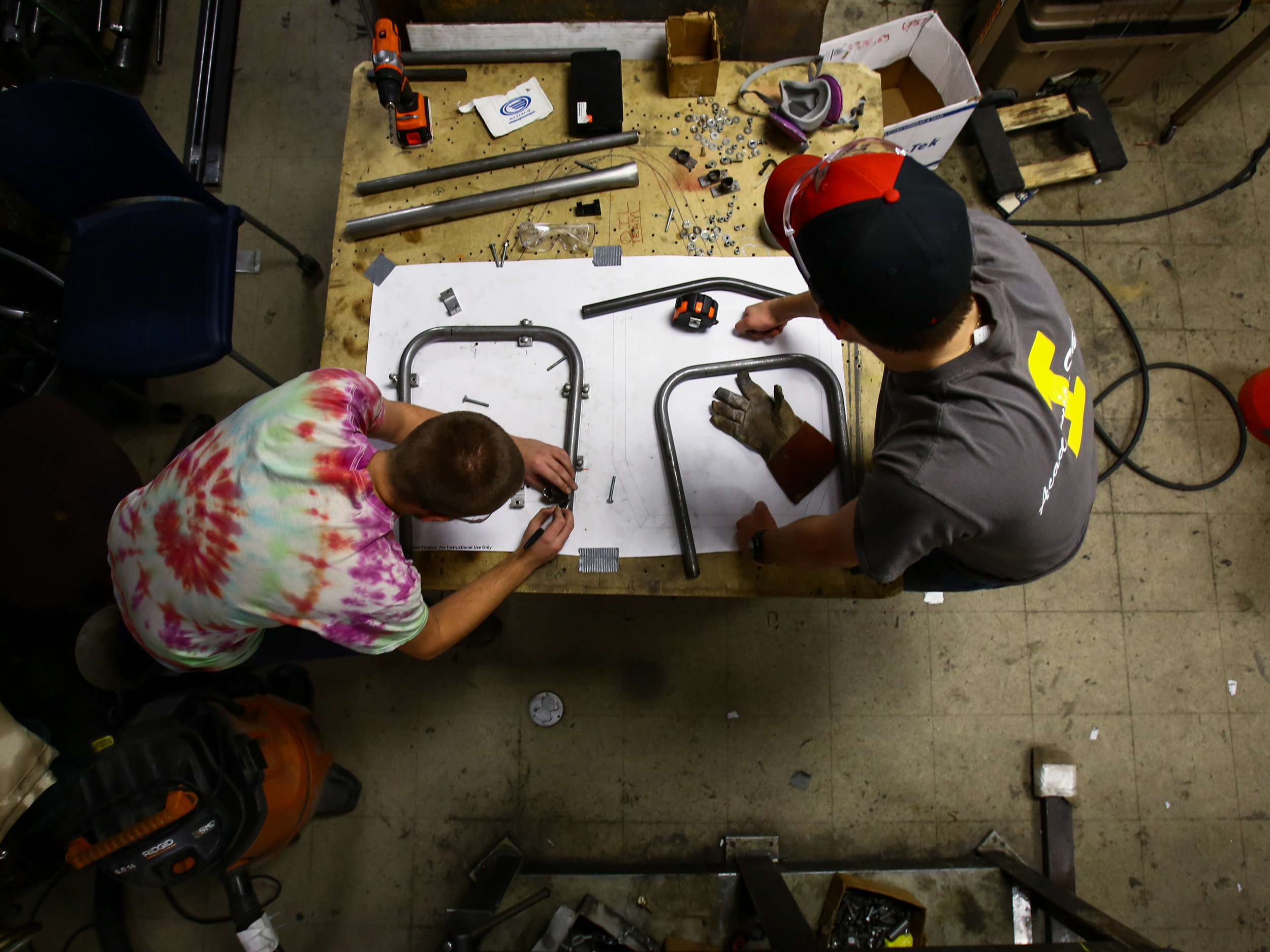 Jared Schaufele, left, and Colin Jedrzejek work on marking and cutting tubing to weld together the front bulk head as they begin to construct the chassis for the current season's car in the Formula SAE team lab in the University of Toledo's North Engineering Building.