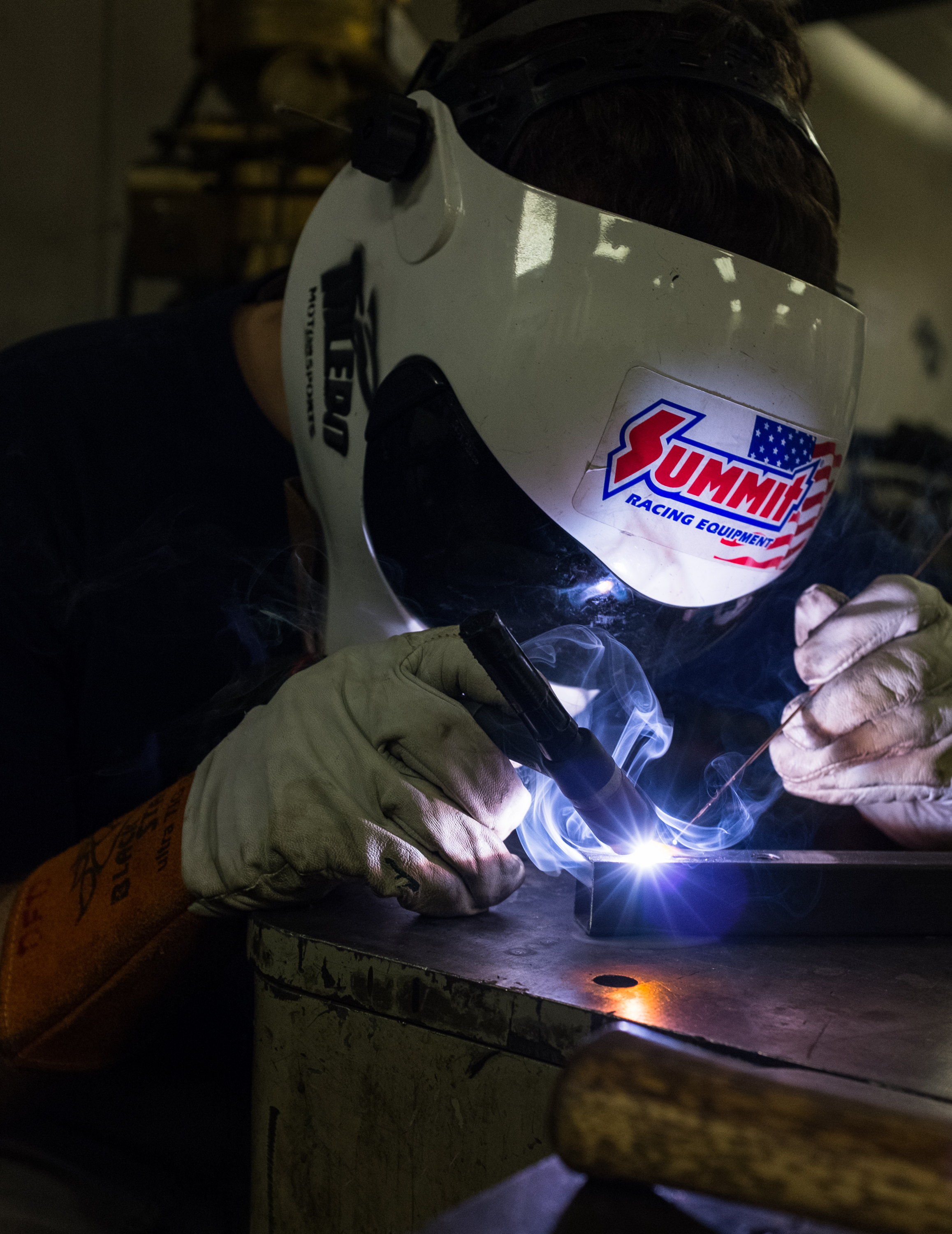 Derek Denti works on welding threaded inserts into square tubing for the front section of the chassis for the current season's car.