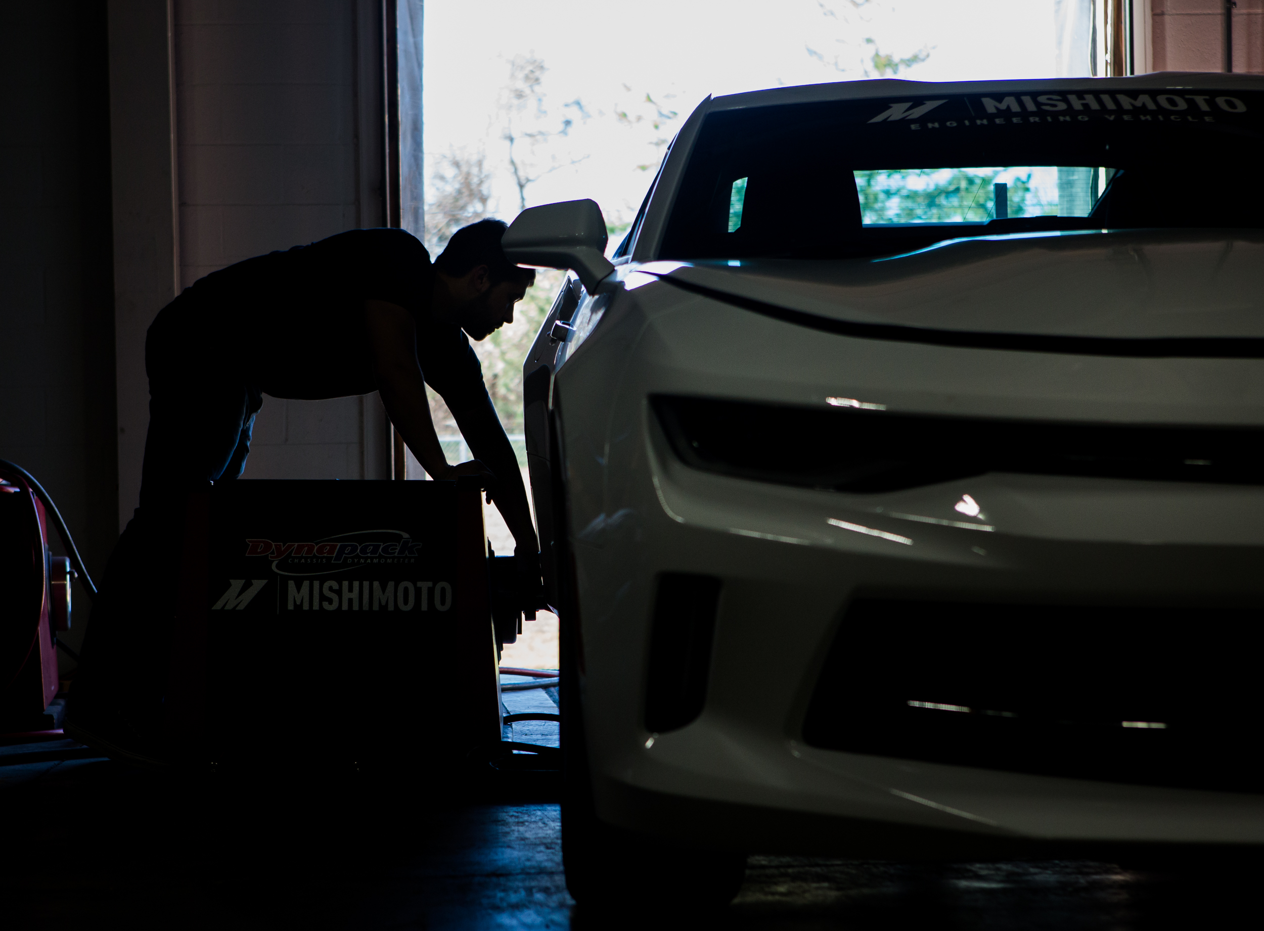 Steve Wiley attaching a dynapack to the rear wheel hub of the 2016 Chevy Camaro 2.0T to test the efficiency of the Mishimoto performance radiator. Click on the photo to learn about what's been happening with this project.