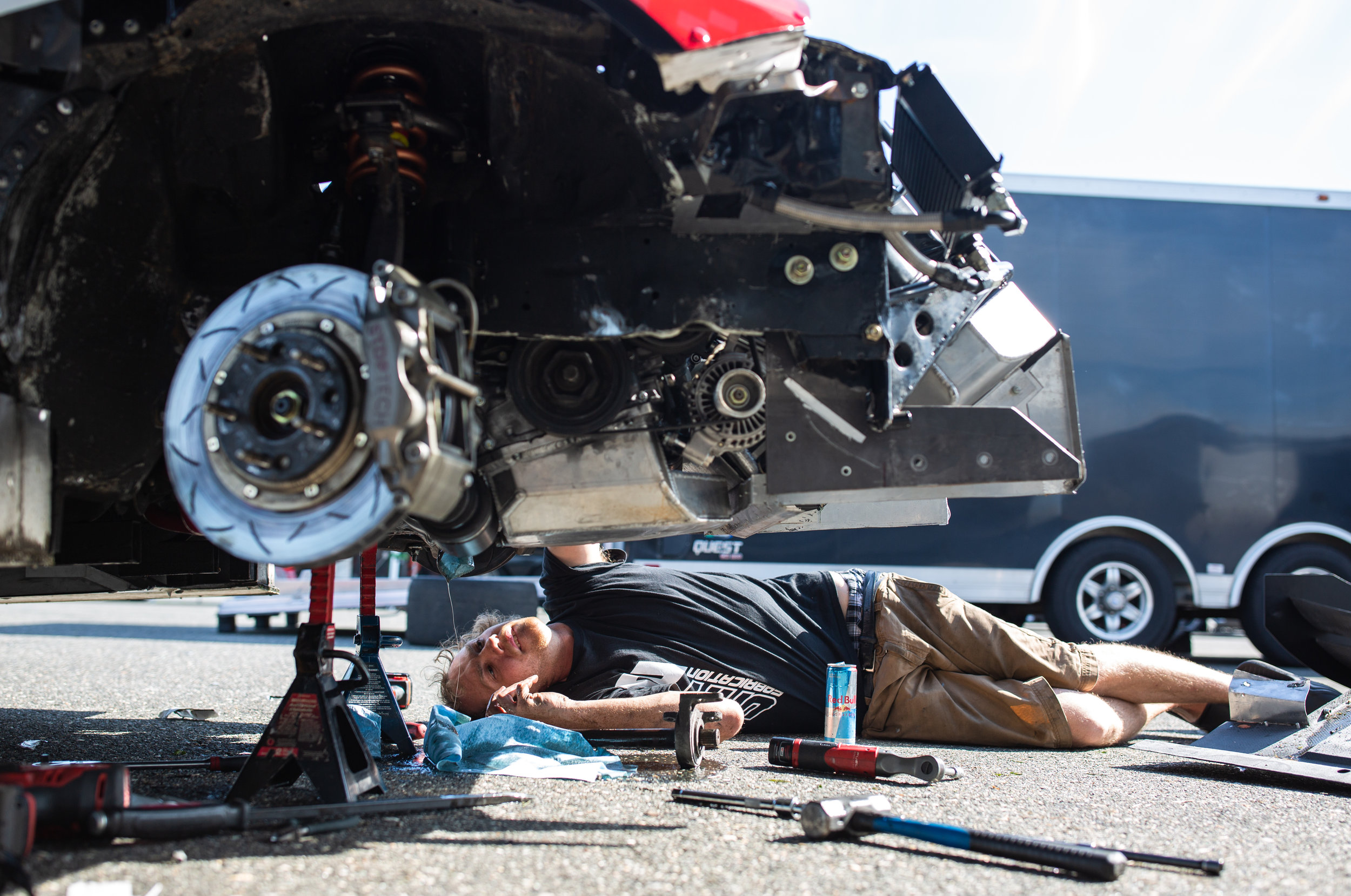 Mitchell Hemmen works on removing a severed axle in the K-Tuned Integra Type R that lodged itself in the car's transmission