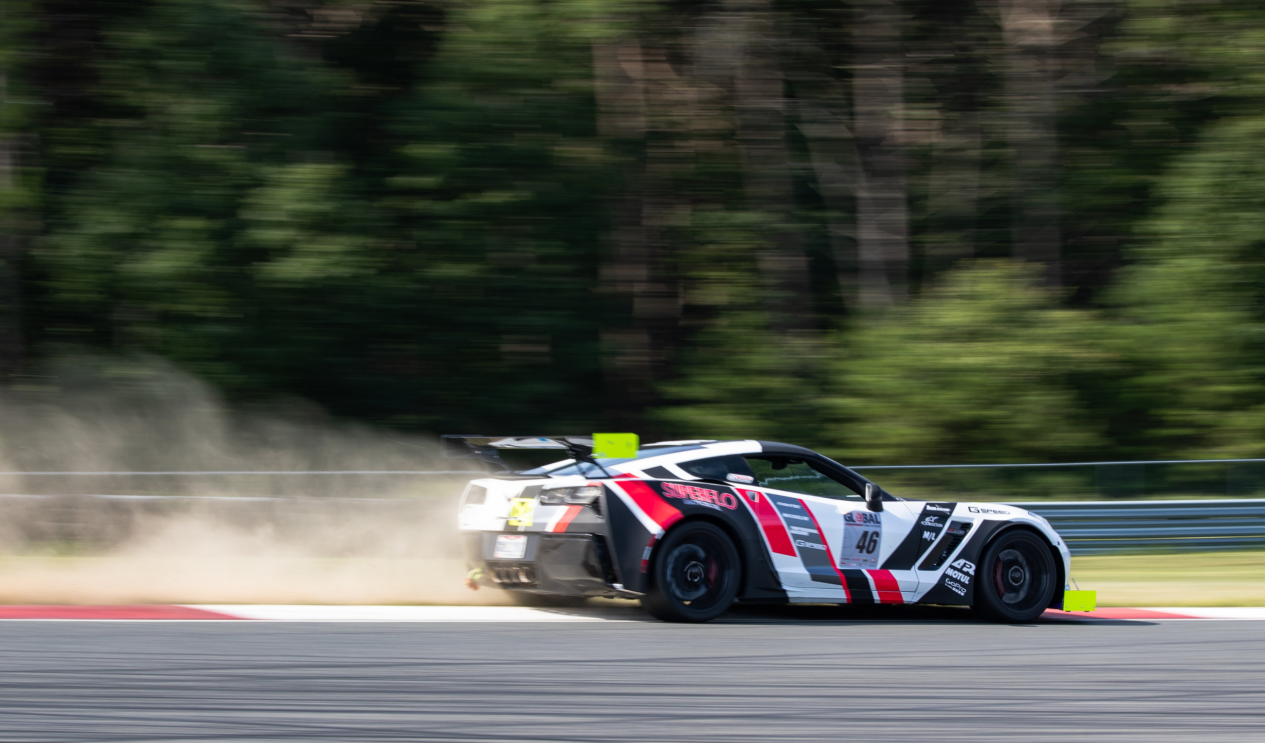 Steven Green cuts turn 1 slightly too wide in his C7 Corvette during his session on the track.