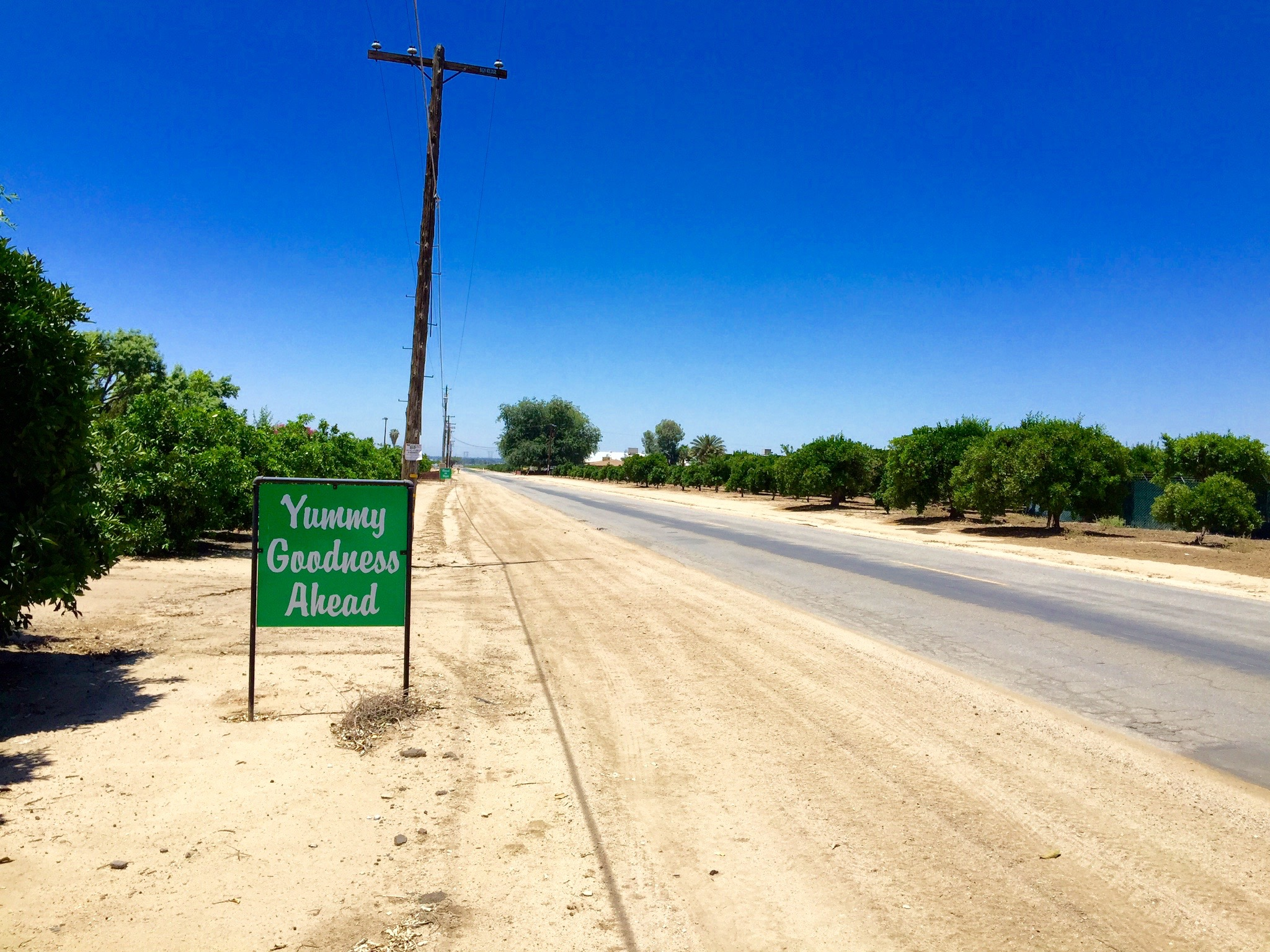 Roadside sign for fruit stand.Central Valley, California