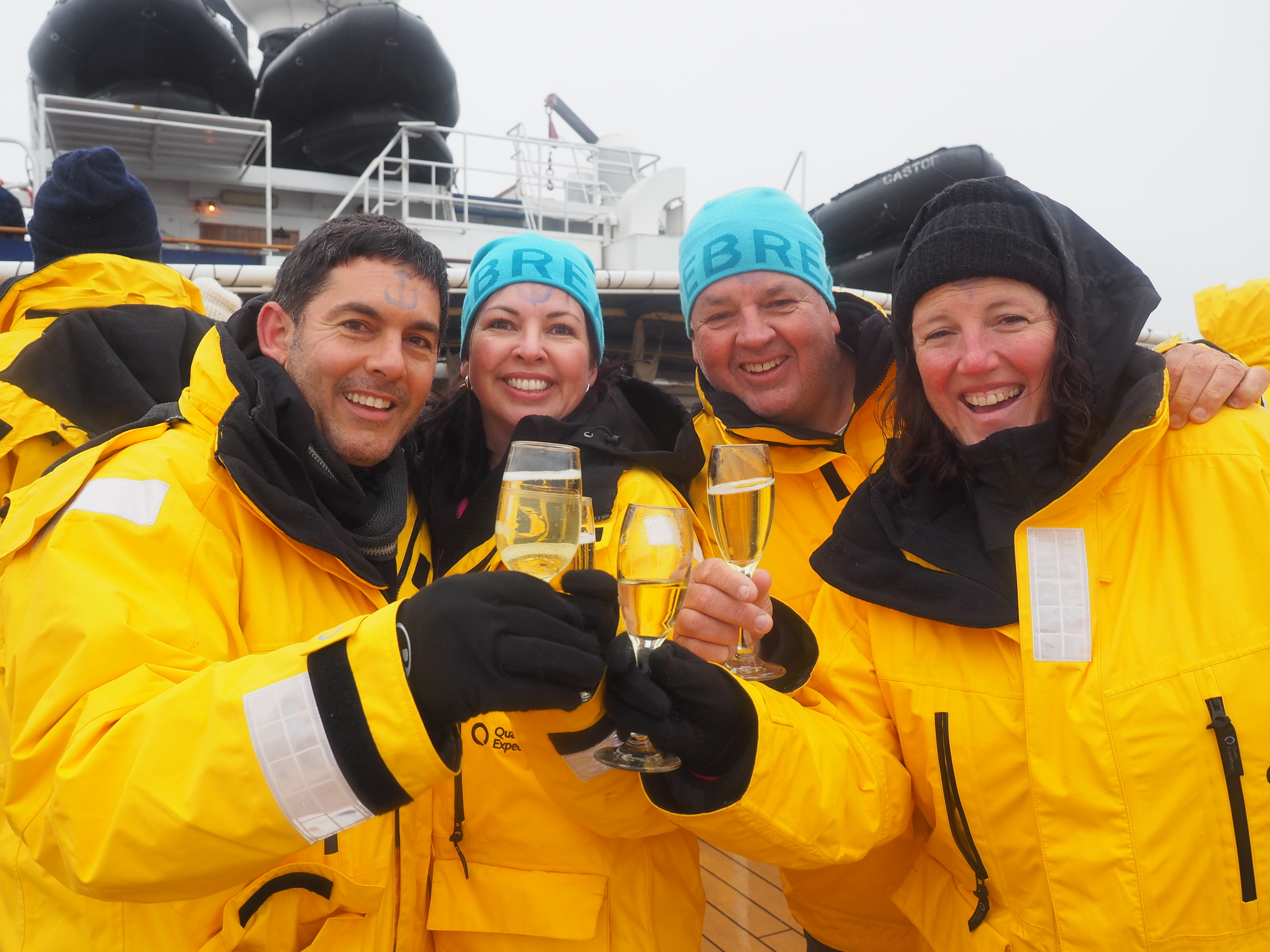 (L-R): Jeff  & Donna Ghaemaghamy with Craig Doyle & Ryll Burgin-Doyle  in Antarctica c elebrating the genesis of 90Degrees Global.