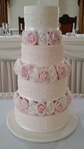 4 tier cake with royal icing piping and rose tiers