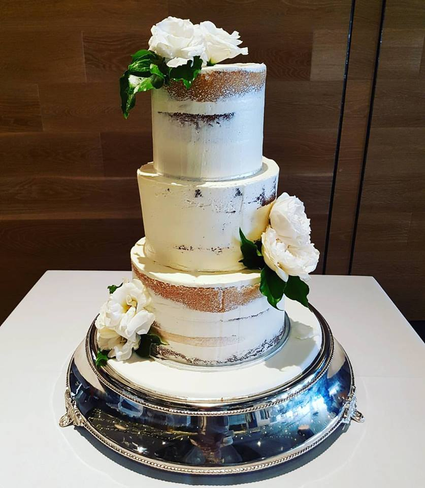 3 tier semi naked cake with flowers