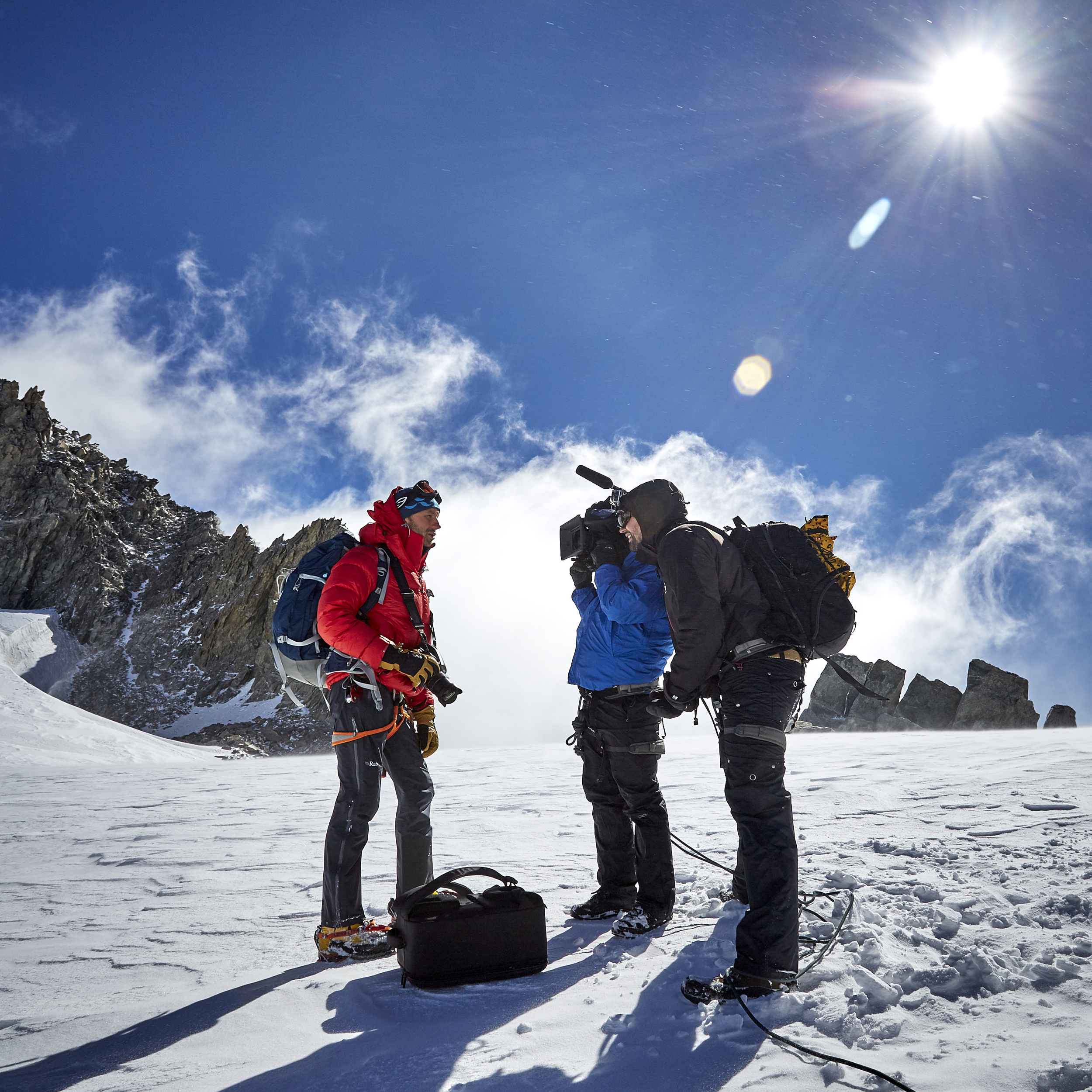 The team conduct an interview at 3300m in the Italian Alps