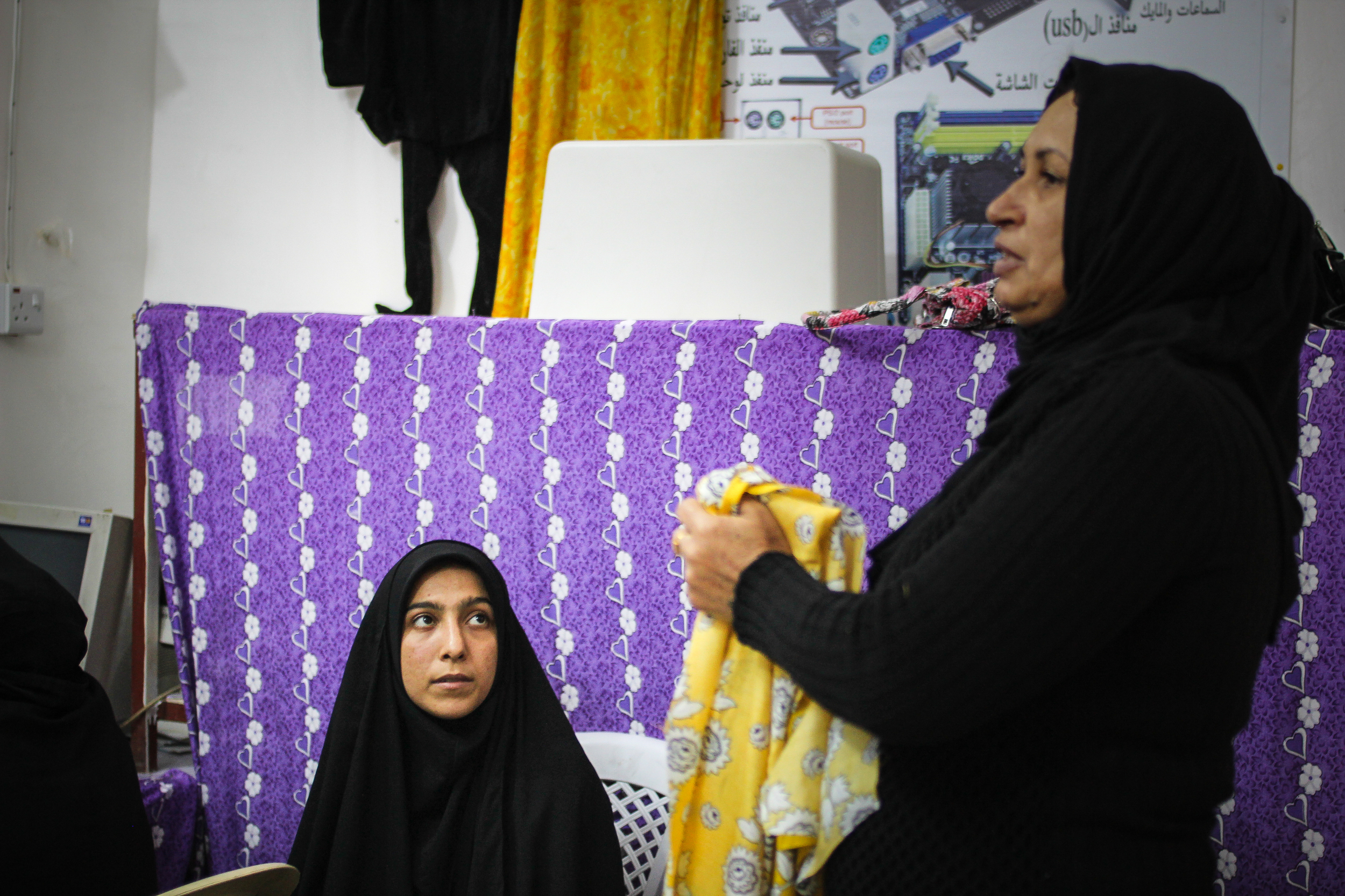 Sewing class, Baghdad / For the Iraq mission of the International Organization for Migration