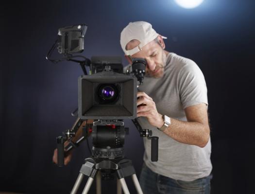 photodune-10065272-young-cameraman-with-professional-camera-m.jpg