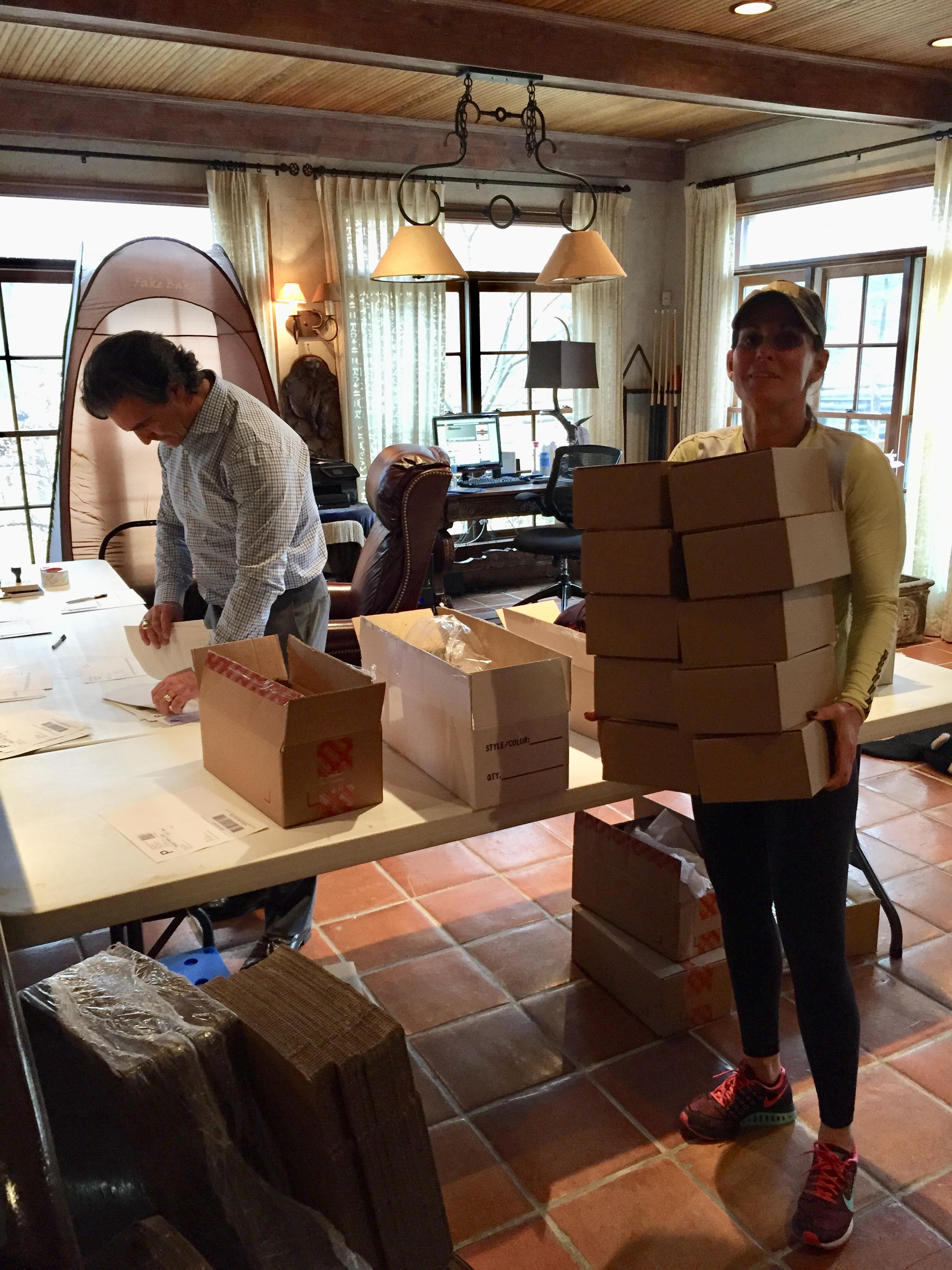 Mom and Pop packing boxes in the basement office March 10, 2015.