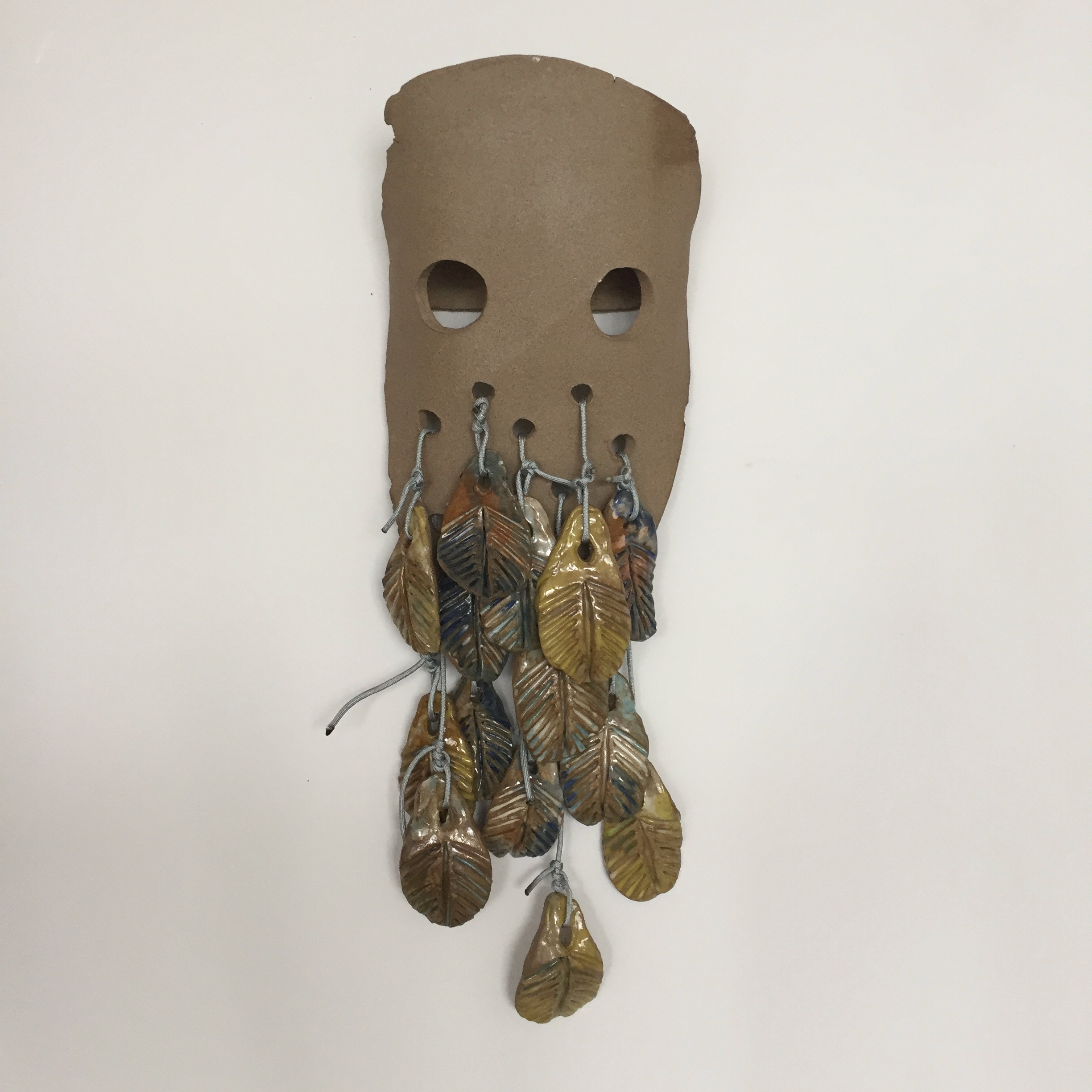 The Thing with Feathers (after Emily Dickinson), 2018, glazed and unglazed ceramic, rope, 24 x 9 x 4 inches