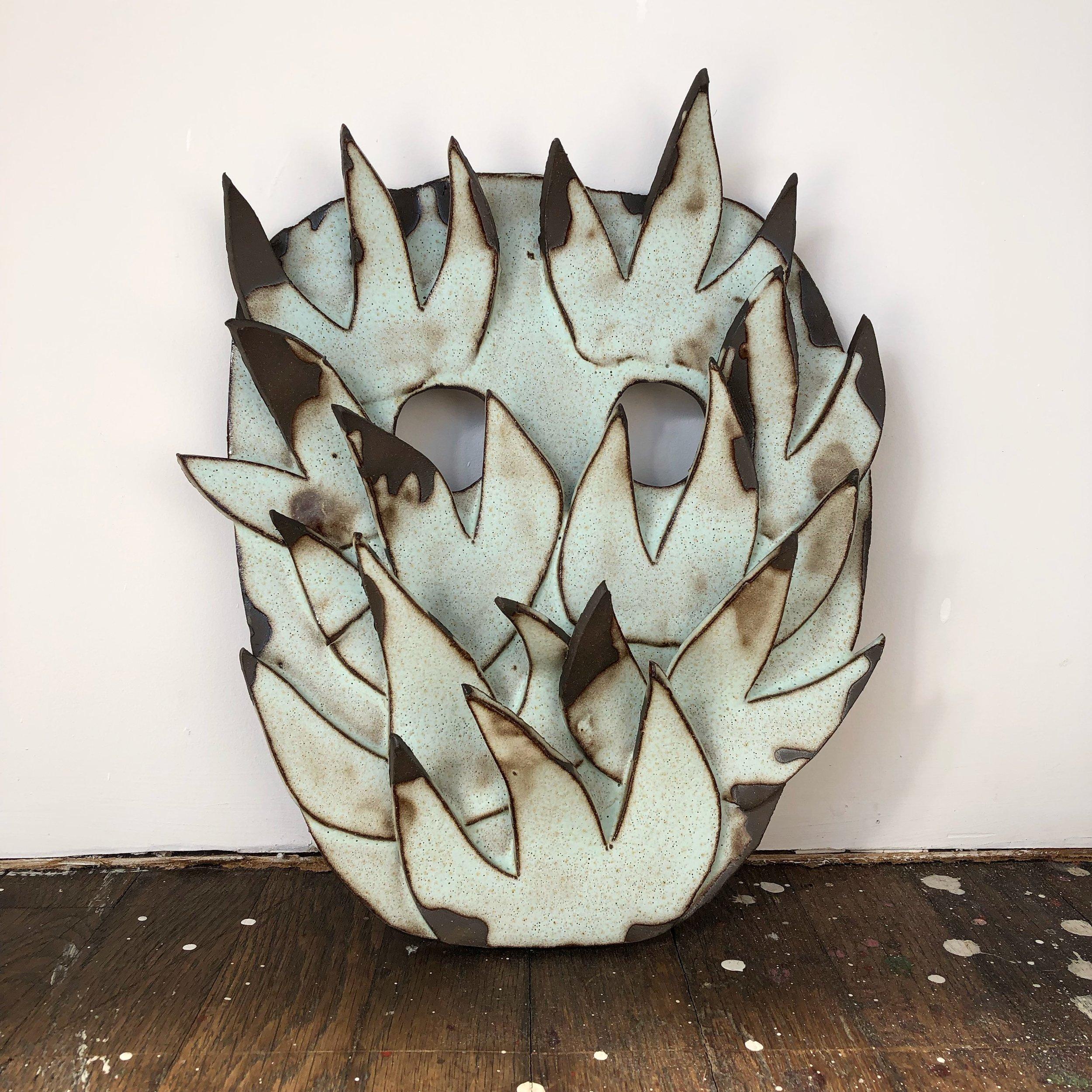 Puck, 2019, glazed ceramic, 10 x 9 x 2 inches