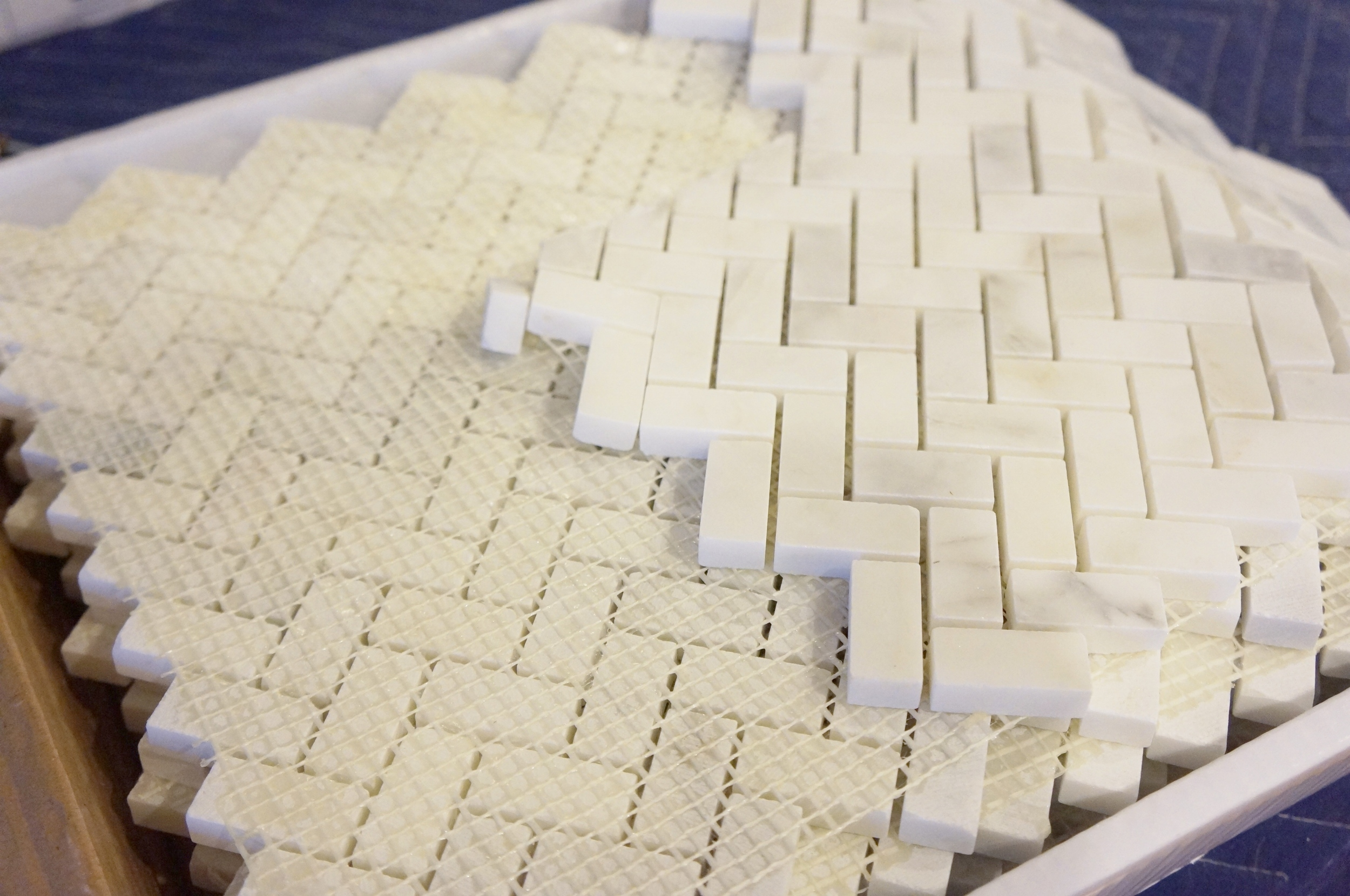 Mosaic marble tile in herringbone pattern