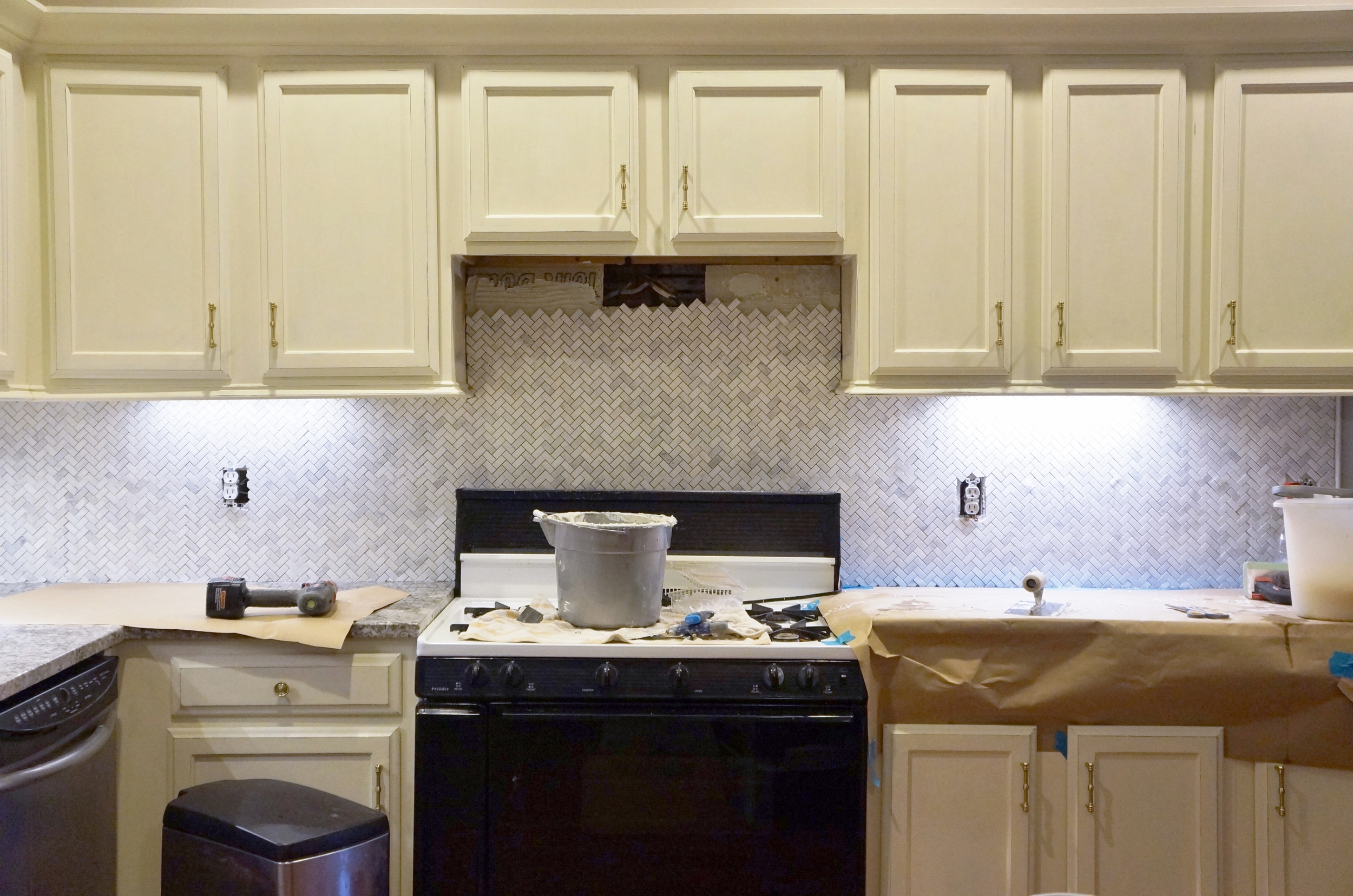 One side complete, leaving room for the new range hood