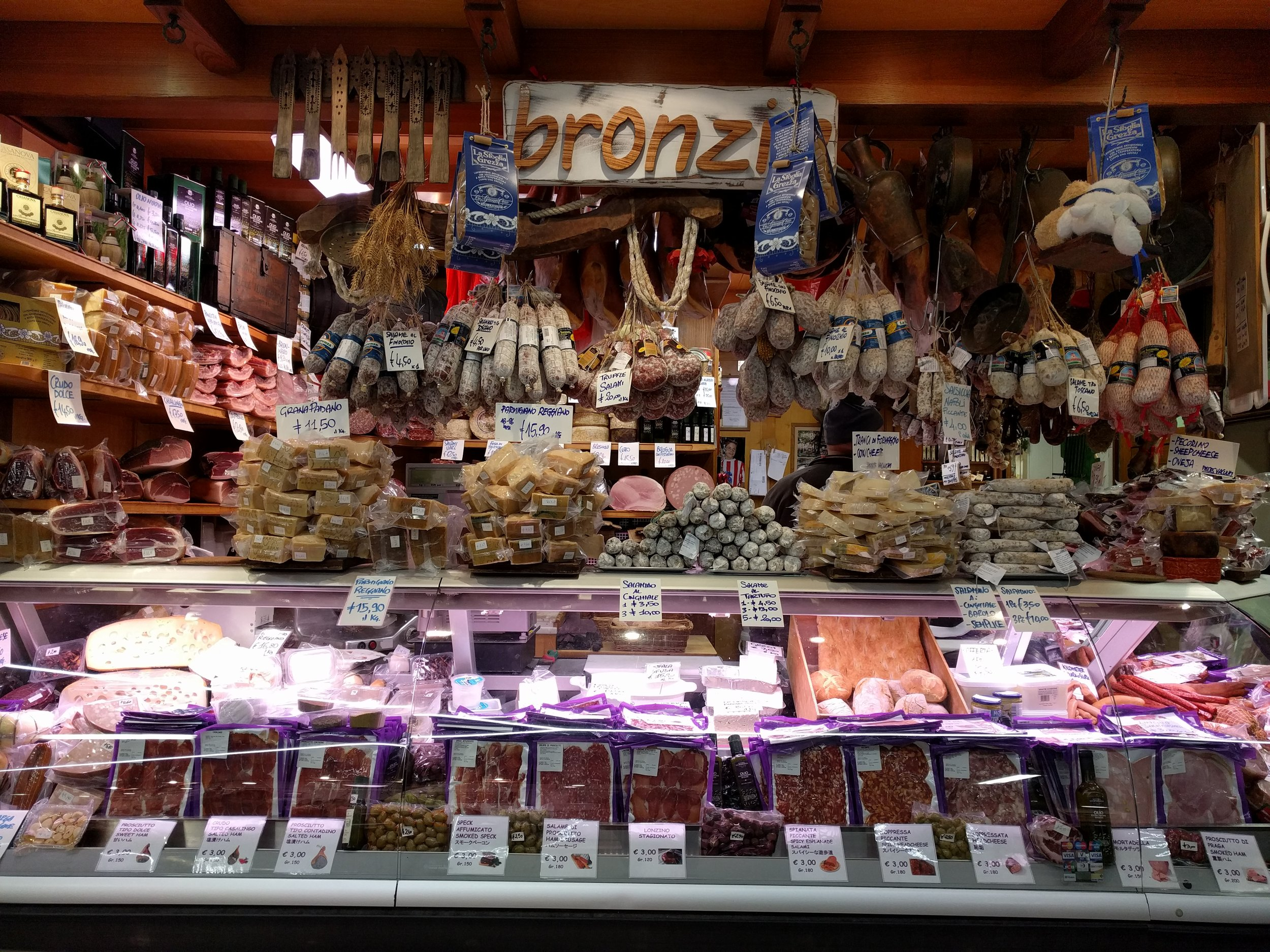 Meats and cheese at the central market in Florence Italy