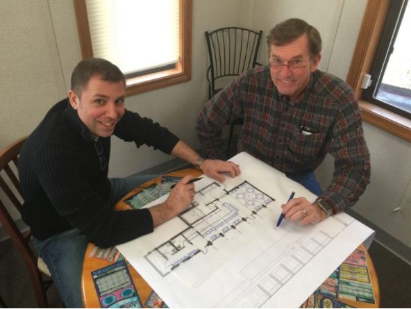 Common Grounds Café owner Wayne Bernard and I reviewing design documents.