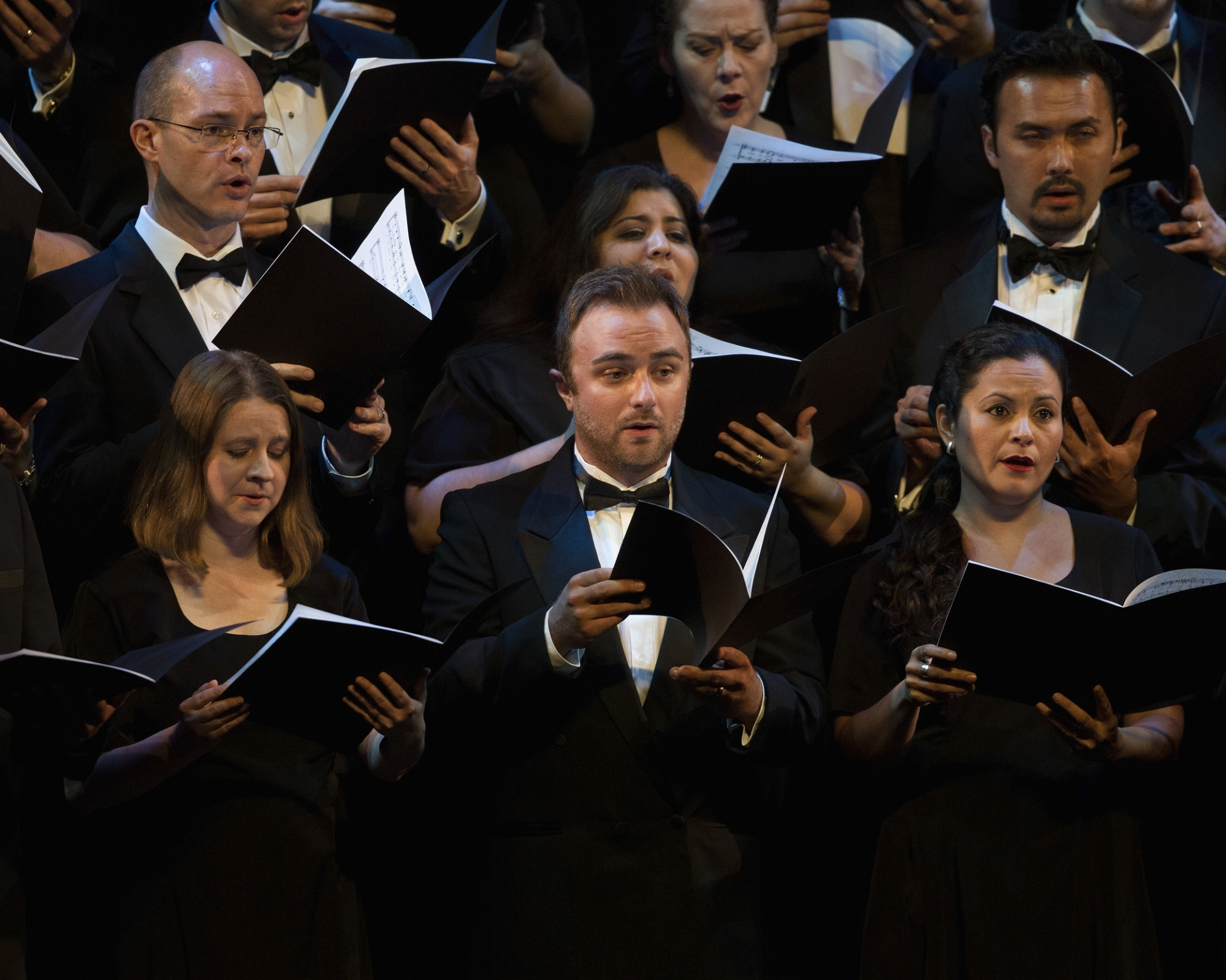 Performance by the Houston Grand Opera Chorus during The UNICEF Audrey Hepburn® Society Ball at Wortham Center on September 6, 2013 in Houston, Texas. (Photo by Bob Levey/Getty Images for UNICEF)