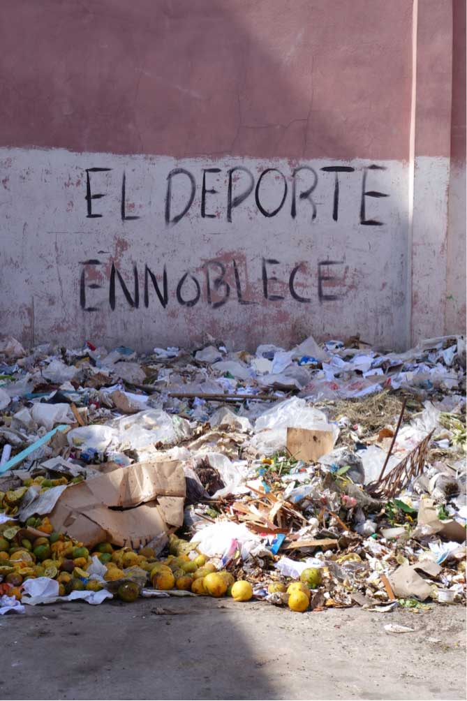 "<p><span style=""font-size:13.125px"">Amongst garbage dump: ""Sports are noble.""</span></p>"