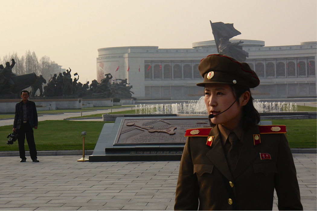 """Our guide at the Pyongyang Victorious War Museum.    Straight out of central casting, our guide at the Pyongyang Victorious War Museum could not have rattled off a more propaganda rich fusillade:    """"We met the imperialists and mowed them down with our brilliant tradition of invincibility and immortal patriotic exploits. With our amazing victory, all of the world would know that we defeated the American imperialists and their South Korean puppets, and left 400,000 American dead.""""Note: actual US dead = 36,000..   (See source.)"""