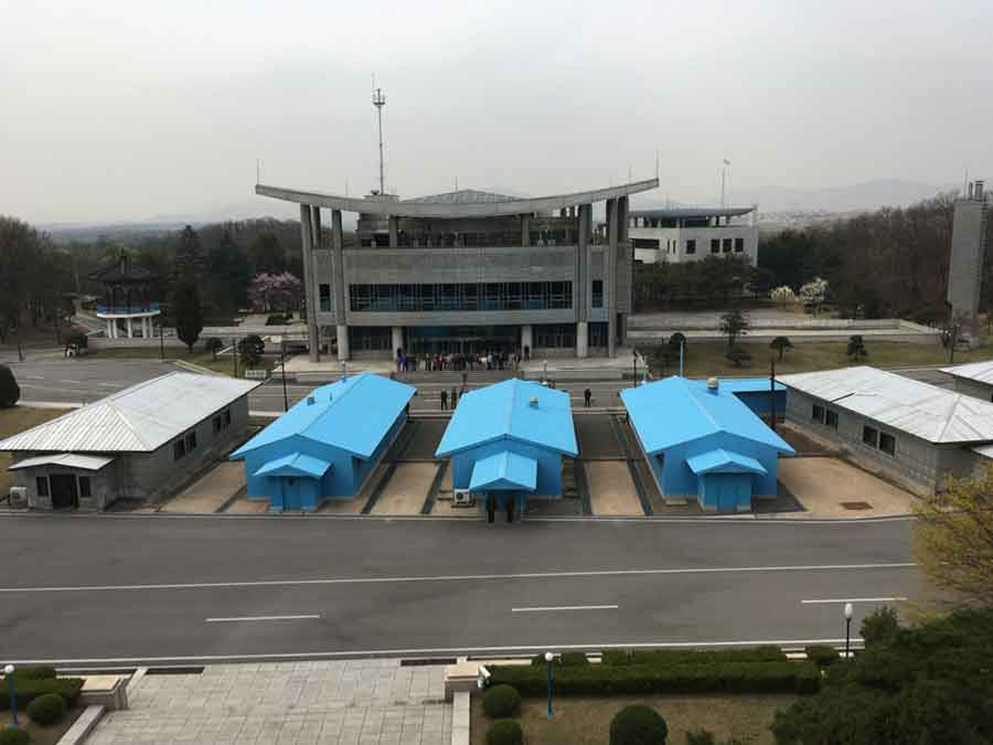 South Korean buildings at the DMZ, as seen from the DPRK. The blue buildings are for joint negotiations and straddle the border.