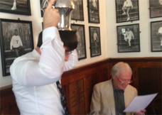 "Jack Newsham '14 [LEFT] finishes the Mory's Cup. Len Stoke [RIGHT] reads the demanding lyrics of the refrain,  ""It's Jack, it's Jack who Makes the World Go Round."""