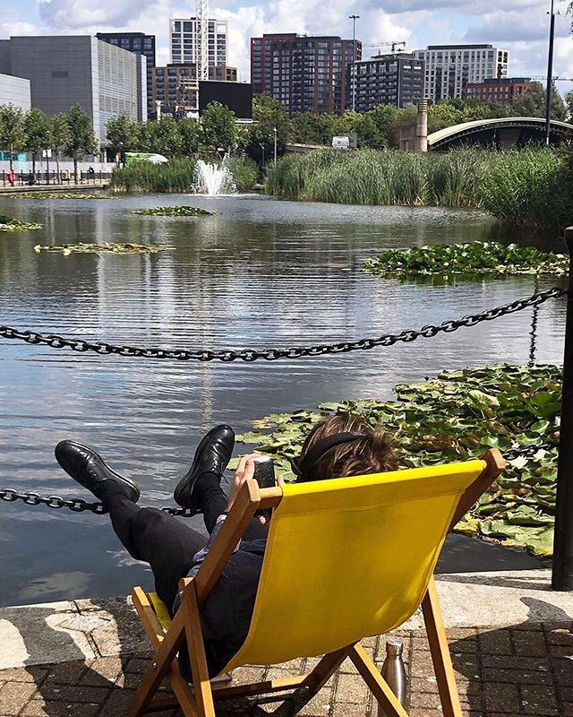 Enjoy the last of the summer sun on one of @Republic.LDN's deckchairs by the pond ☀️ ⠀ .⠀ .⠀ .⠀ #summer #lunchtime #publicrealm #heatwave #deckchair #officelunch #summerlunch #eastlondon #towerhamlets #poplar #republicldn #eastindiadock #food #icecream #treatyourself #livemusic #lunchisserved #water #exterior #exteriorshot #architecture #office #officespace #publicrealm #lunchspot #pond #nature