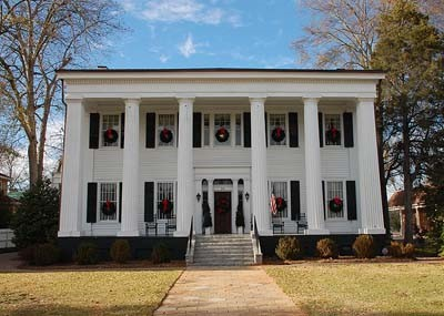Madison Heritage Hall    www.friendsofheritagehall.org   706-342-9627  Located in the heart of downtown Madison, Georgia, Heritage Hall opens its doors to welcome guests daily. The home is maintained by the Morgan County Historical Society and has been restored for its architectural and historical significance. Period furnishings provide an elegant and functional setting for public and private events.