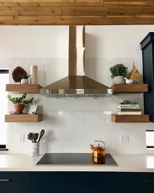 "Finally finished styling the floating shelves in the new kitchen... although they'll probably go through a few rounds of revisions before they're truly done.😝 Breaking the ""rules"" and mixing metals... when you can't decide between copper, brassy gold and stainless steel... why not use them all? 🤷🏼‍♀️✨"