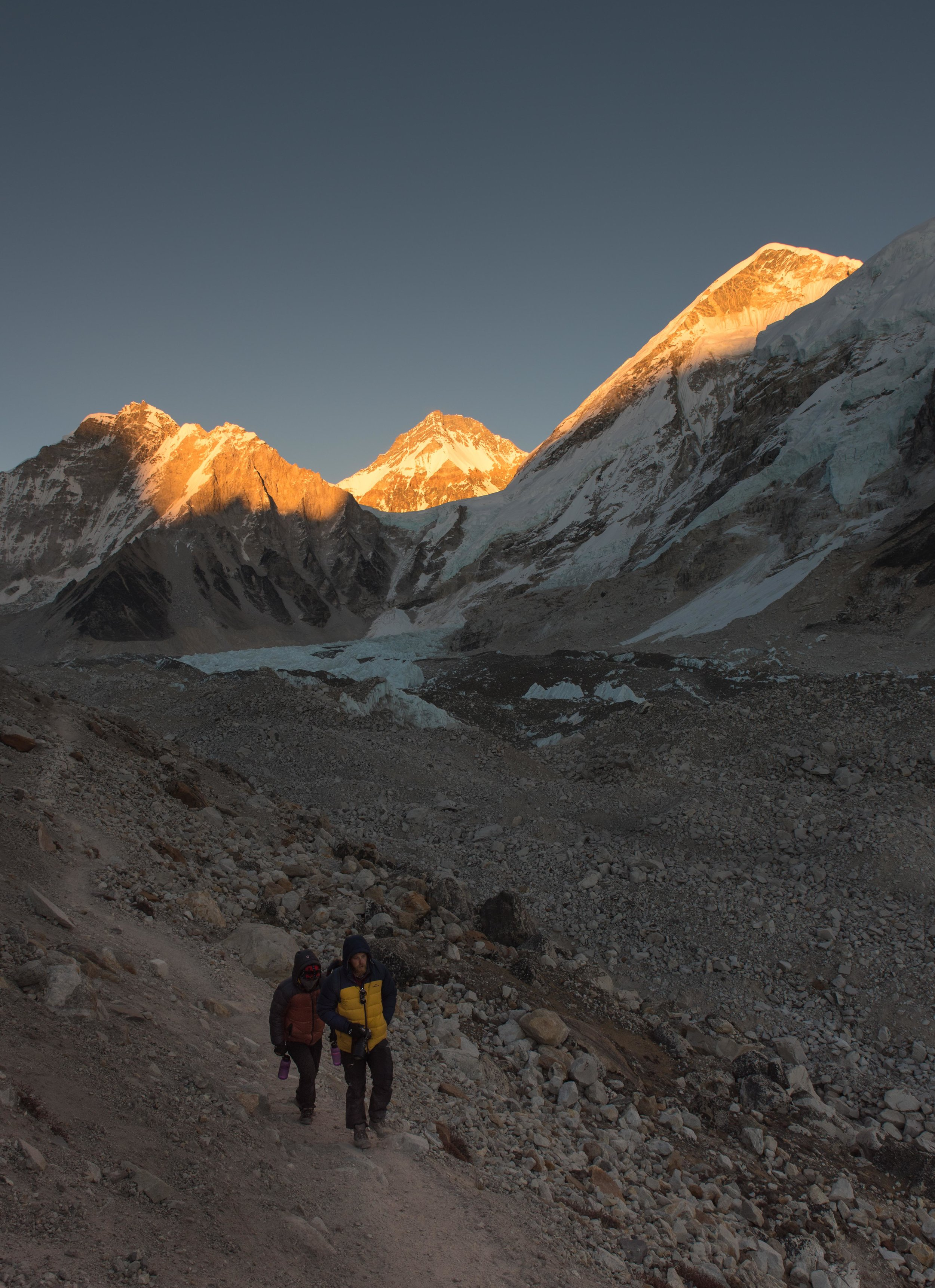 The slow hike back from Base Camp as sun sets in the mountains PC @ryangraymedia
