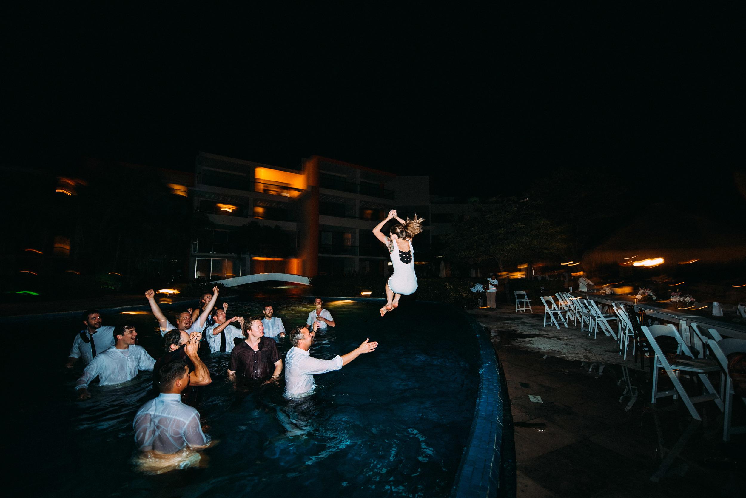BrideJumpsInPoolMexico