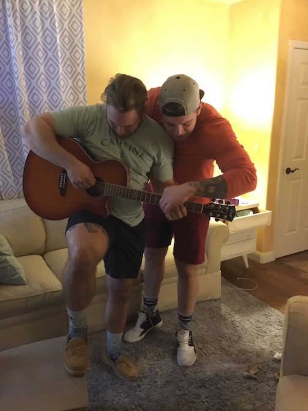 Wes kitts and sam duval playing guitar together.