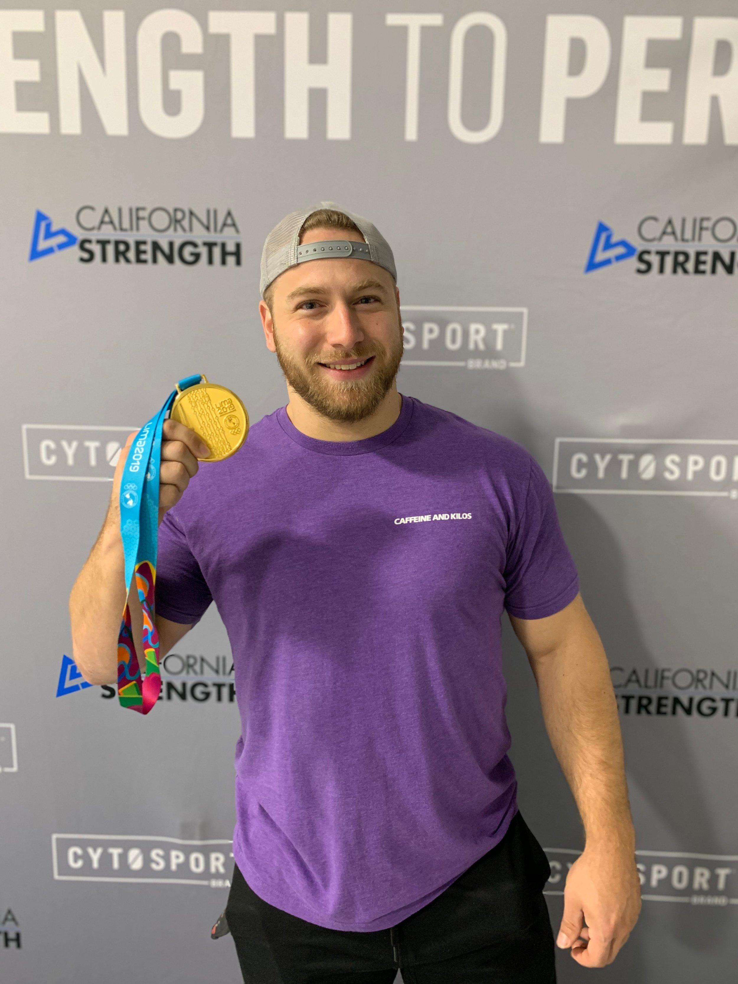 Wes Kitts Holding Gold Medal