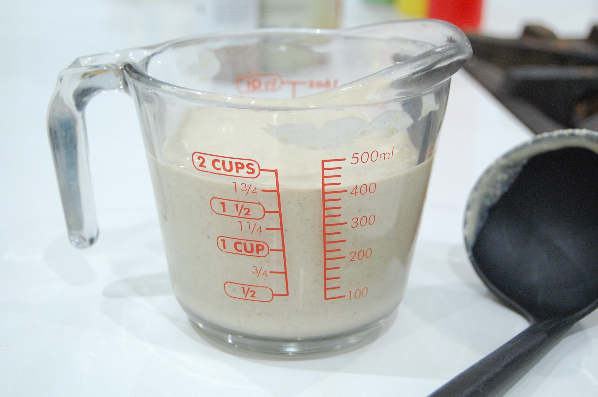 I pour my batter into a measuring cup so it's easier for me to get my ladle in there to spoon out uniform amounts onto the griddle.
