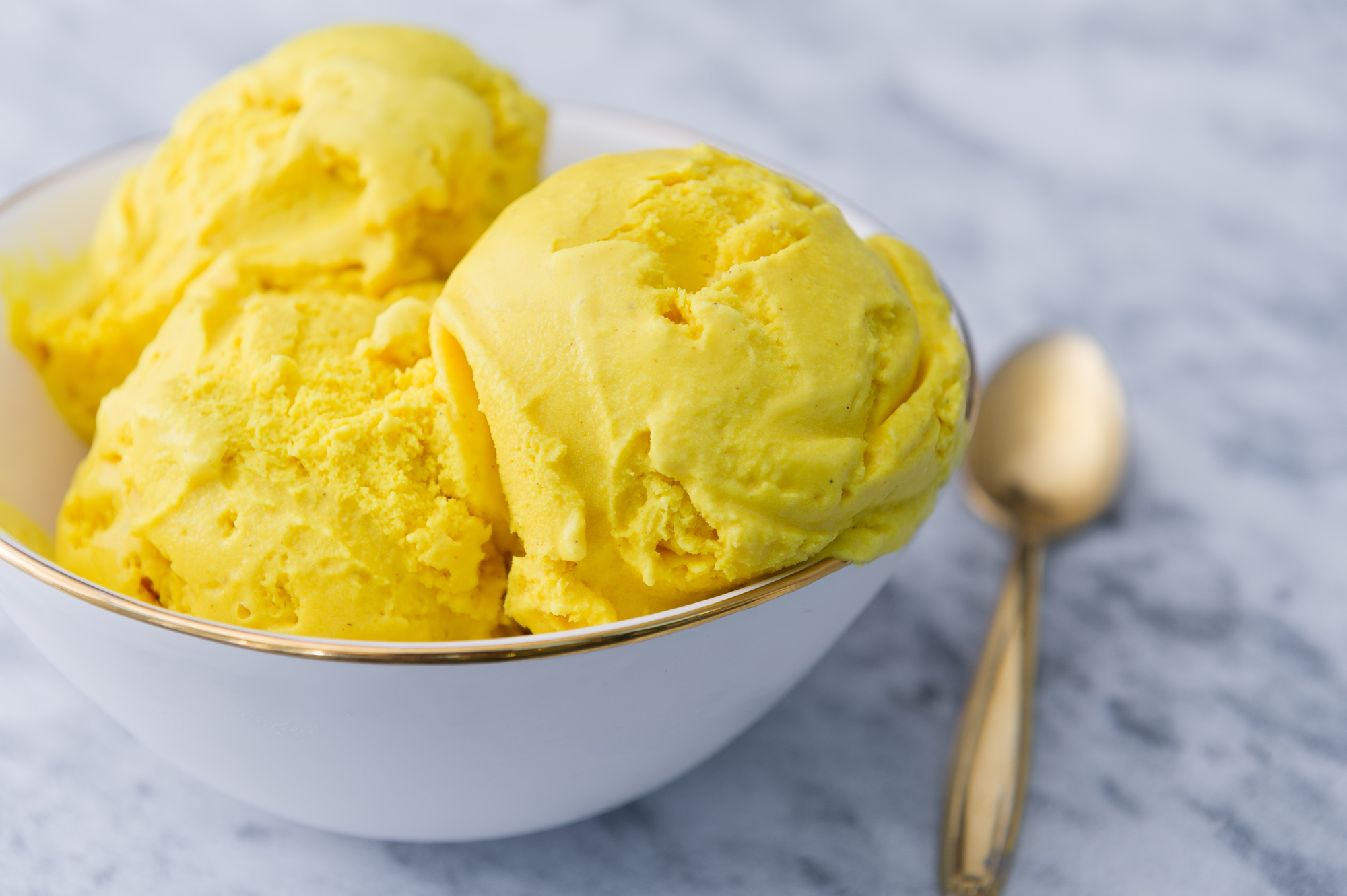 GOLDEN TURMERIC<br><strong>An earthy flavor, accented with ginger, and a spice blend, this ice cream tastes as bright as it looks.</strong>
