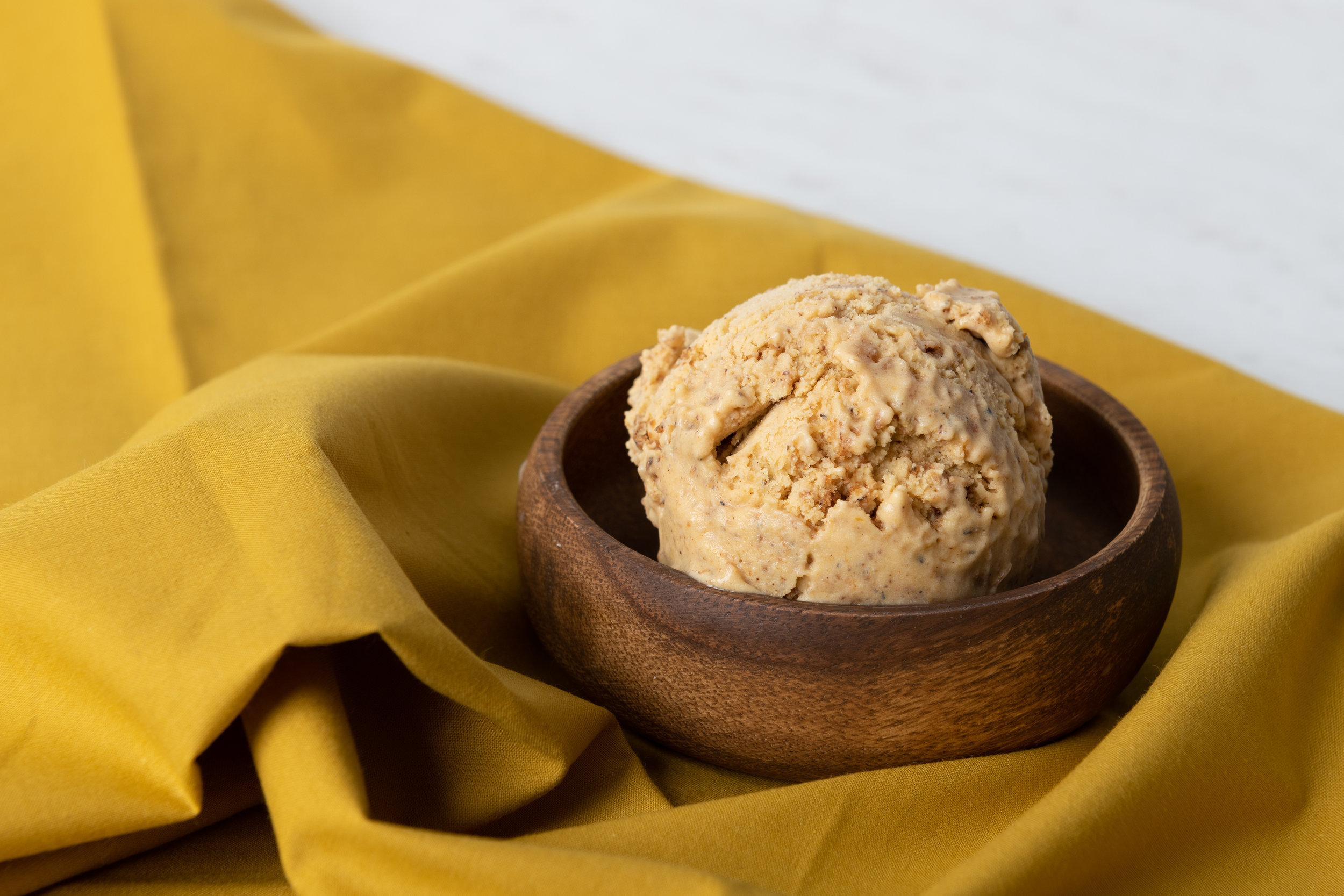 PUMPKIN GARAM MASALA CRUMBLE<br><strong>A pumpkin ice cream with the sweet and savory spices of garam masala, with a smoky black cardamom graham cracker folded throughout.</strong>