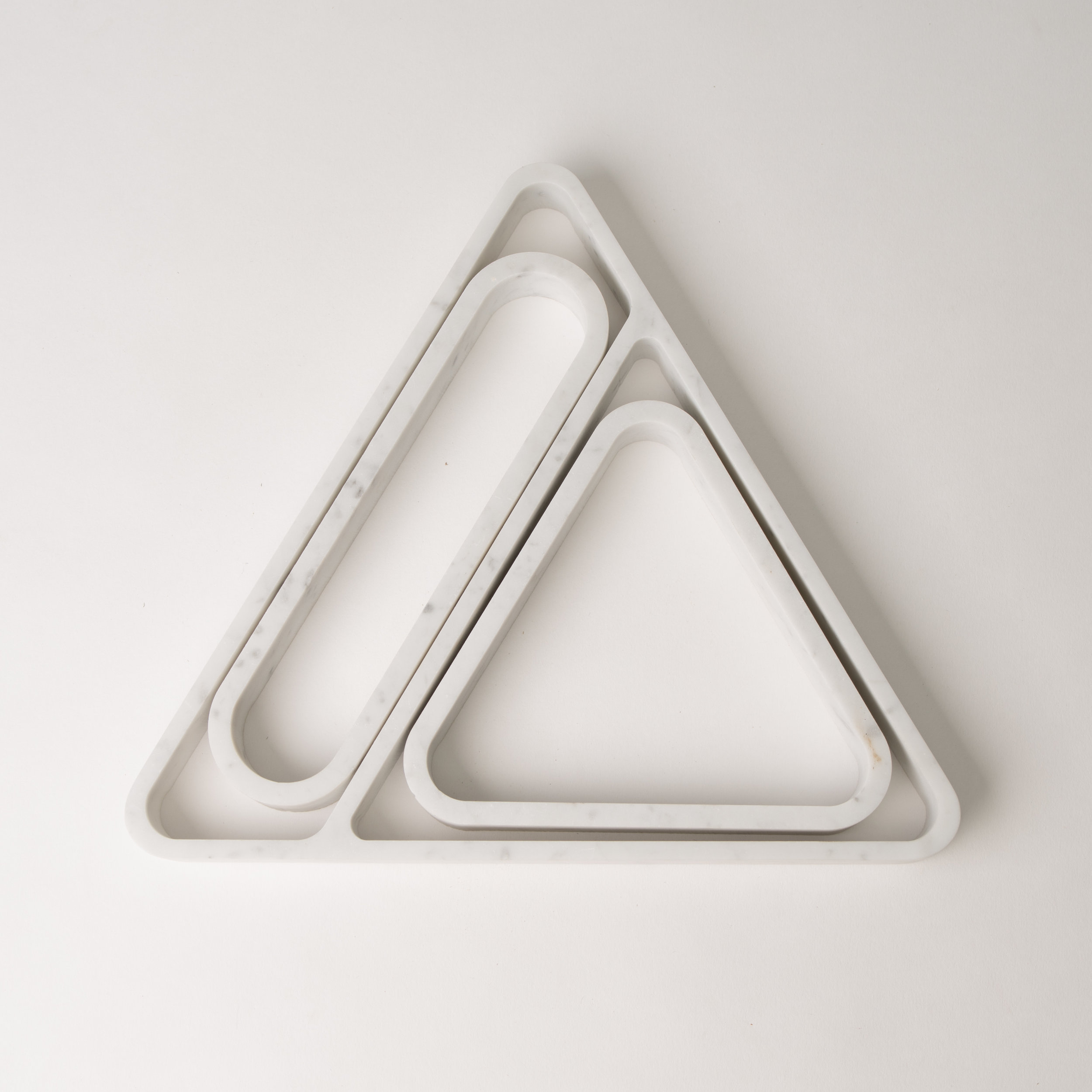 Smaller trays offset from the larger shapes maximizes material and cuts down on waste. -
