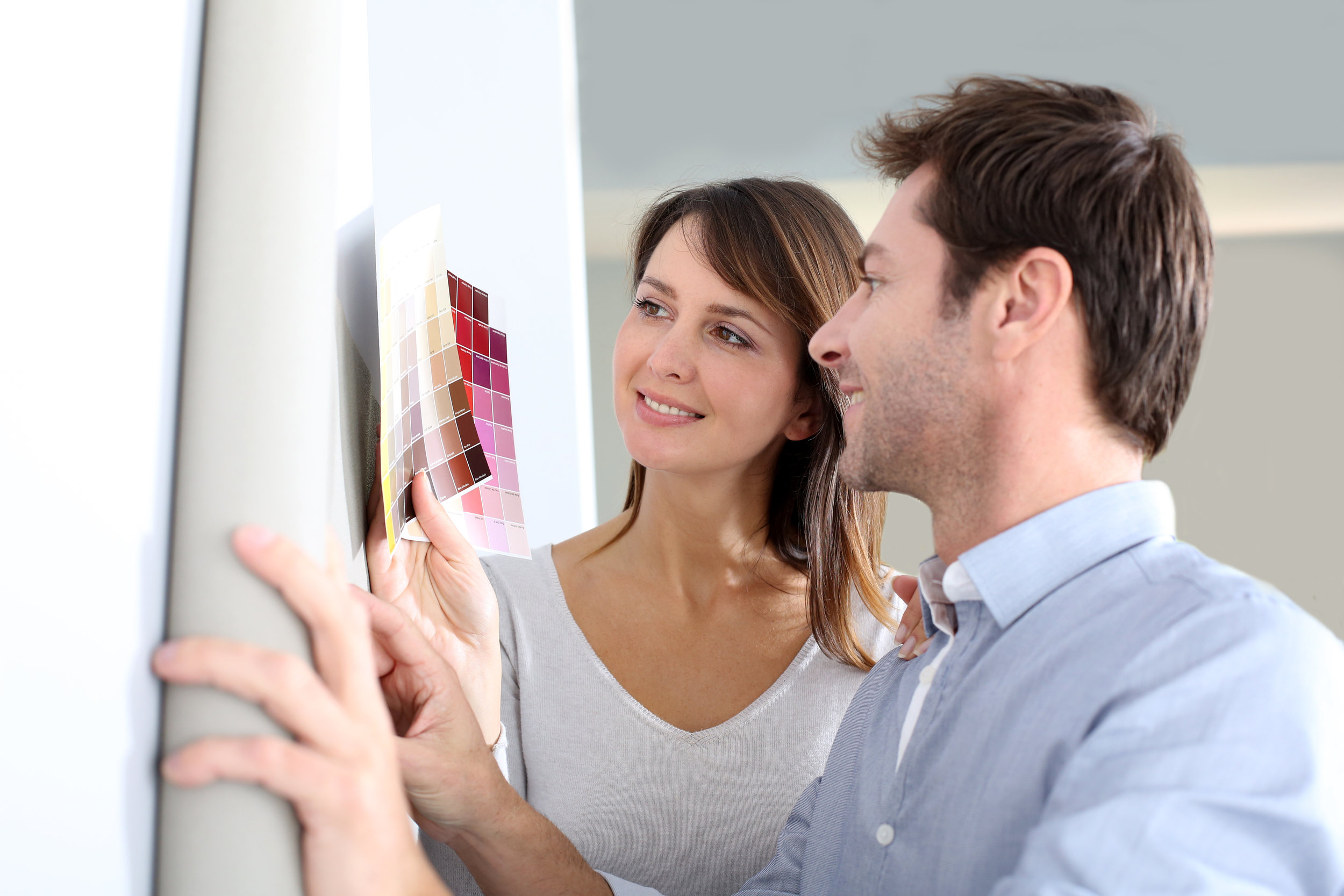 stock-photo-couple-choosing-paperwall-colour-for-their-new-home-115951597.jpg