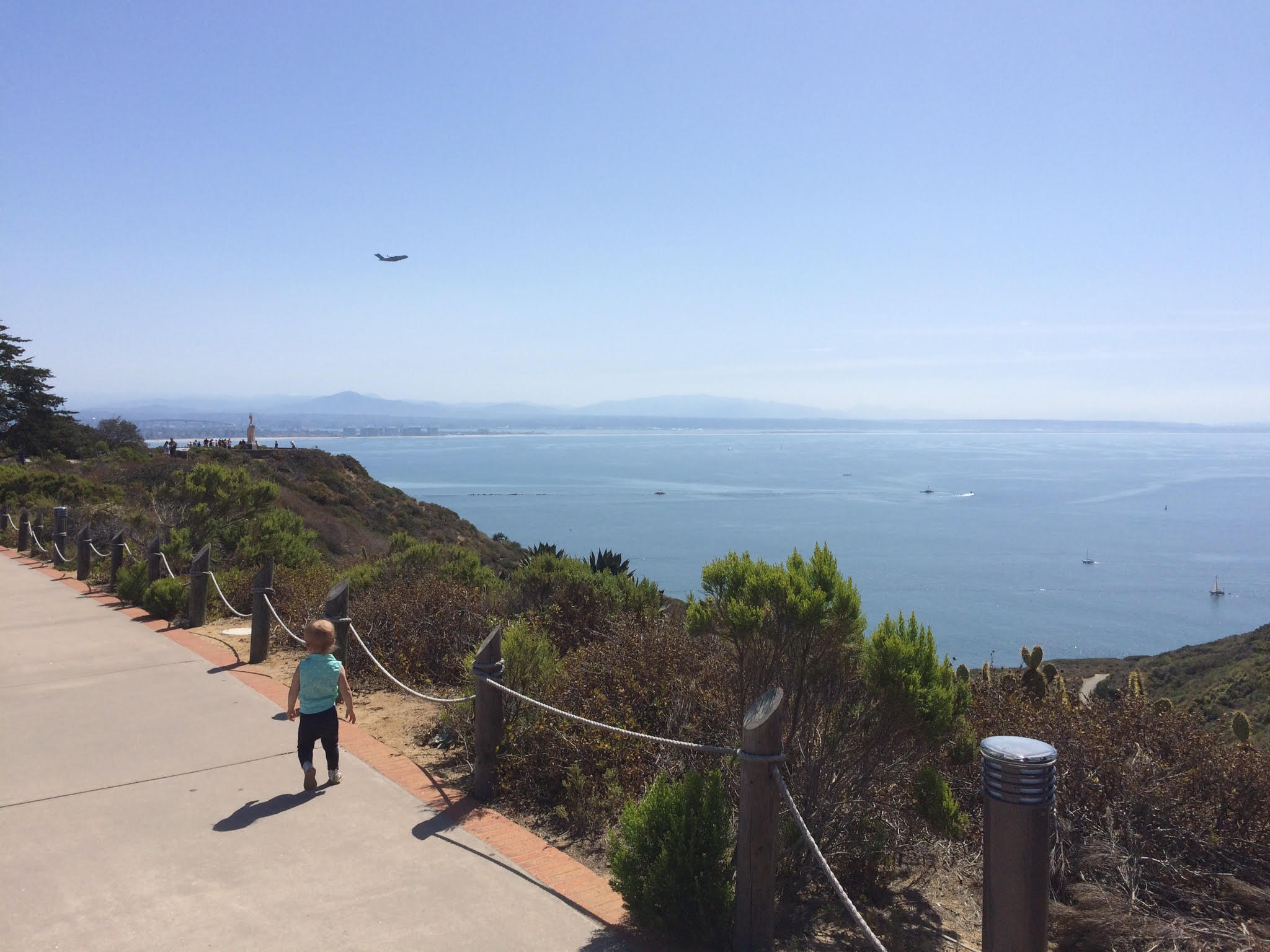 Olivia running to watch the airplanes at Point Loma in San Diego, CA. April 2015
