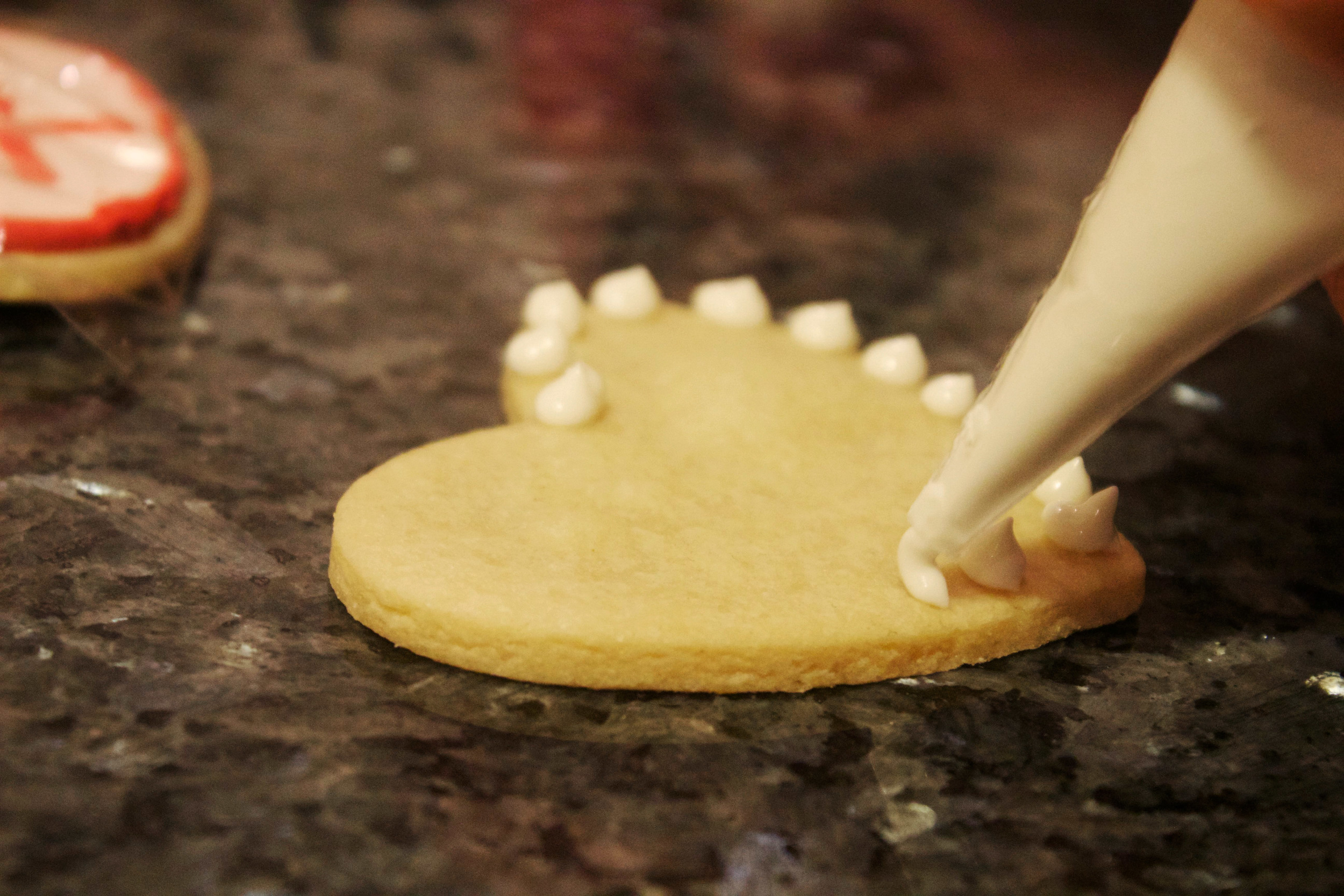 decorating heart shaped cookie