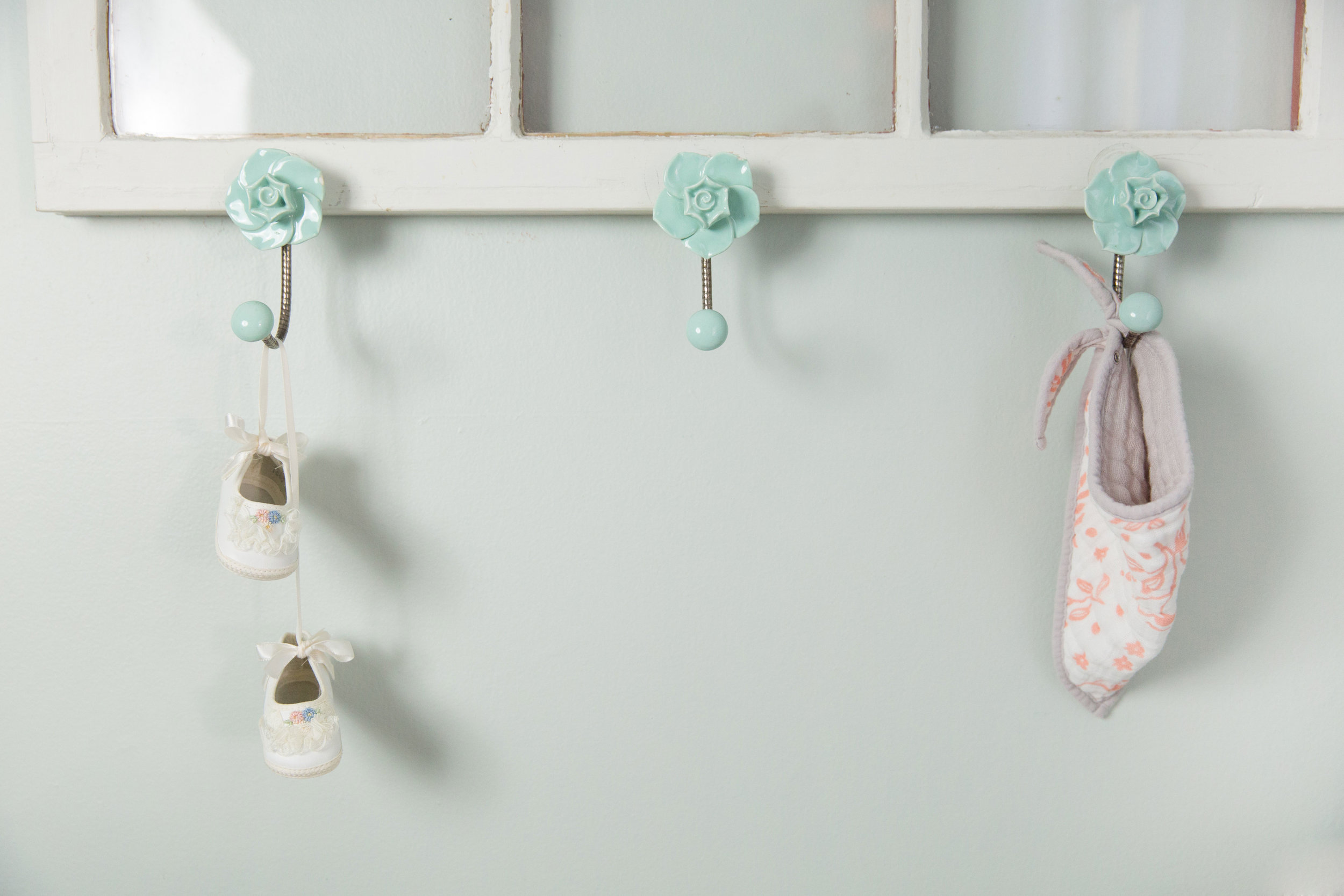 Baby Shoes Hanging in Nursery