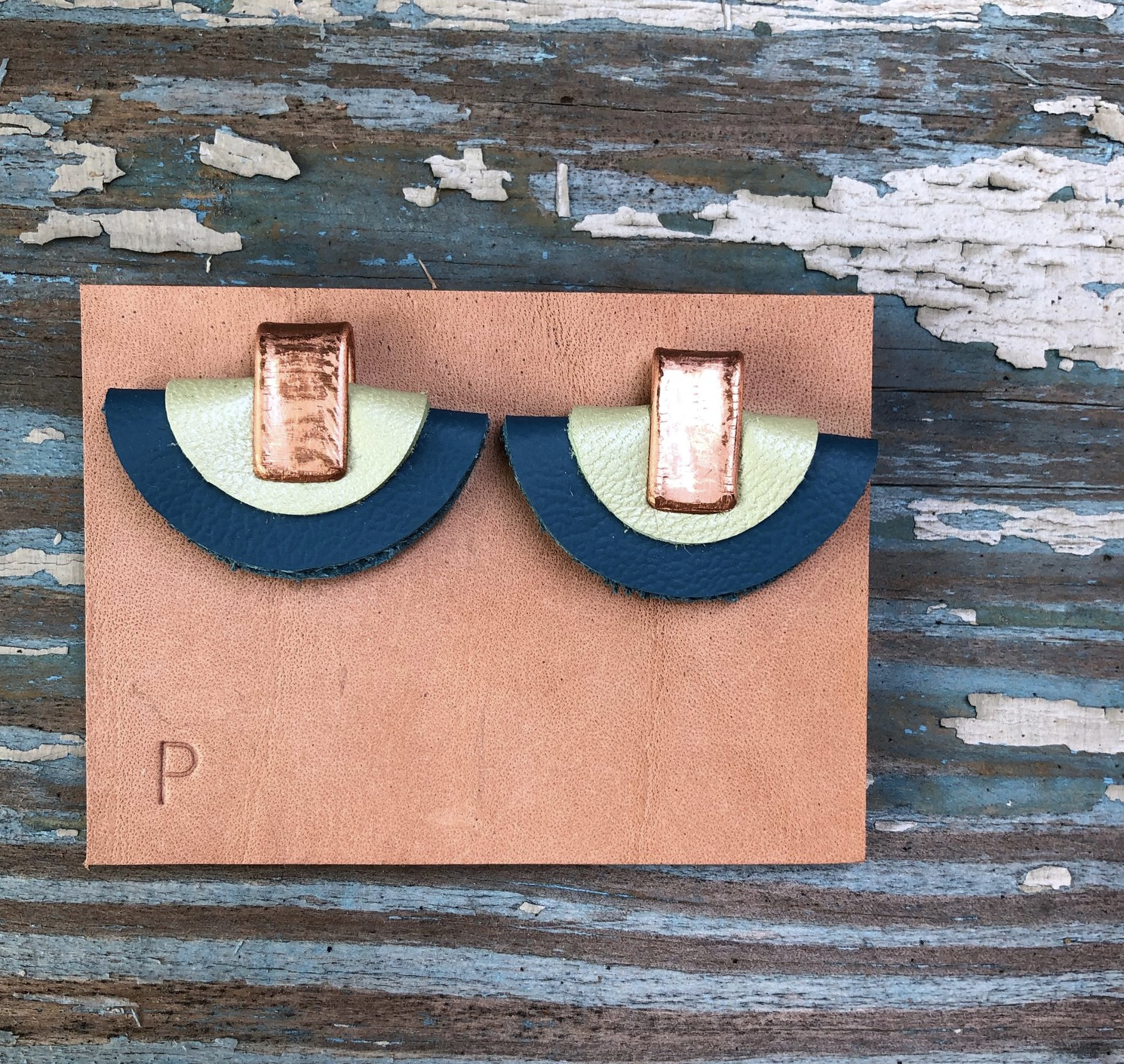 Leather earrings by Penelope Design Studio