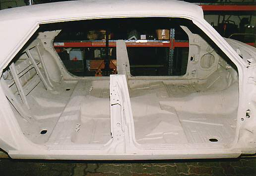 Right Side View Of Body After Sandblasting And Priming