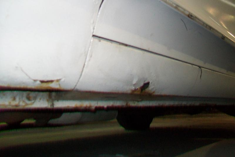 Rocker panel and front fender rust. One of the most common areas for these cars to start rusting. The previous owner filled in the holes with newspaper and putty, and covered the whole area under the skegs with gravel gaurd, but the holes came through shortly after. The gravel gaurd was removed and luckily this was the extent of the damage. I'm surprised that it wasn't worse, afterall I had the car for over 20yrs.