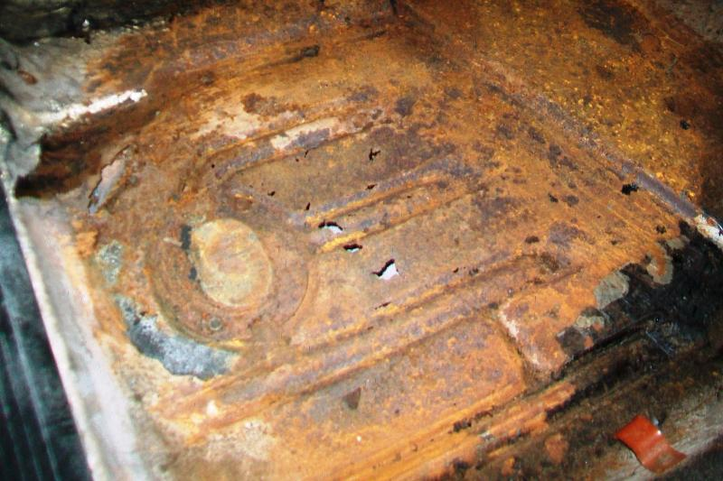 Driver side floor pan rust. Initially , it was my intention to bring the car in for body work and paint. Although the car was up on a hoist when I brought the car in to get an all encompassing assesment, the floor pans did not appear to be to bad. It was when they were prepping the car and cleaning the floor with a wire brush did all the holes appear. Although not figured into my budget, It would be pointless to do the body and not take care of a serious festering problem.